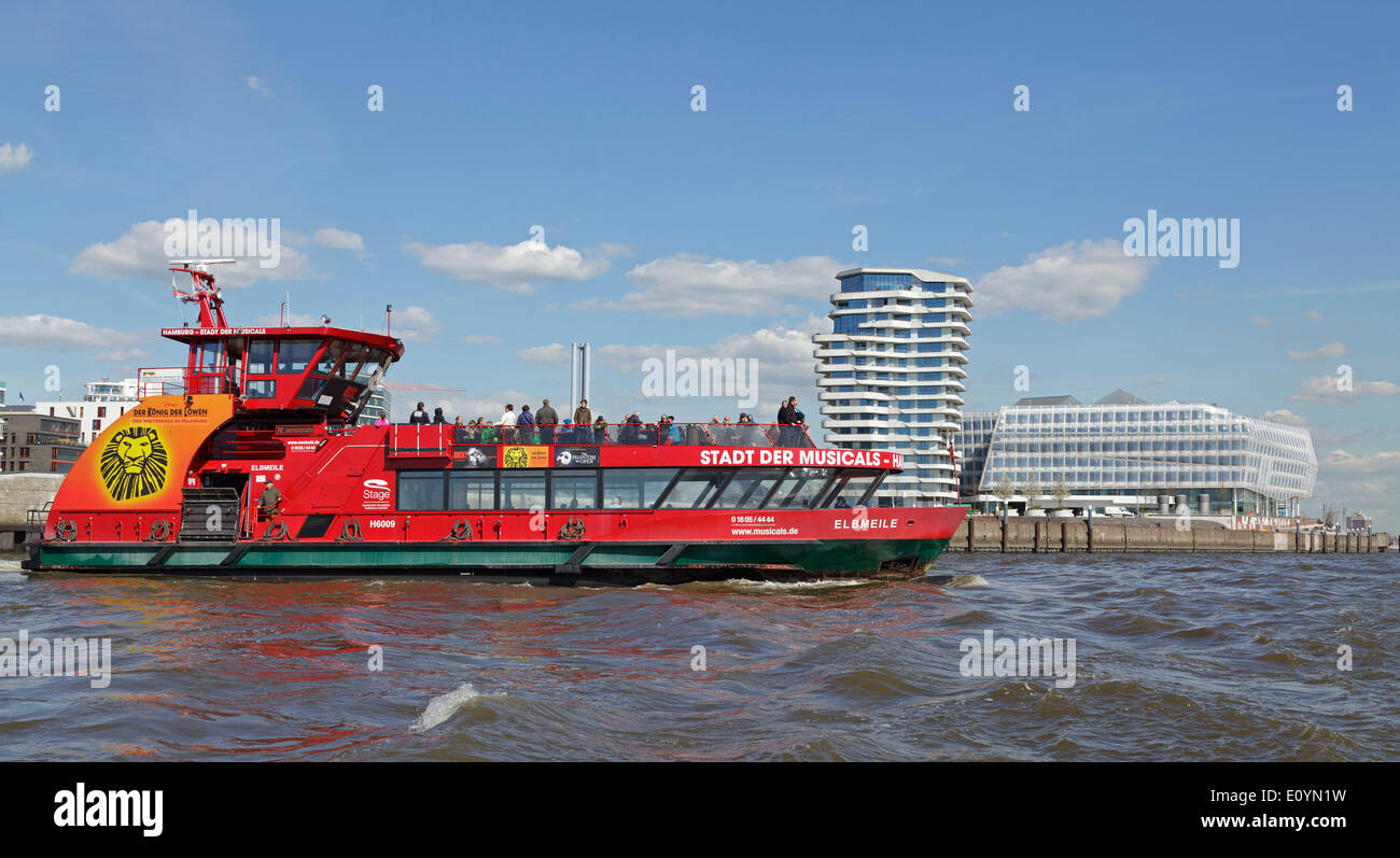 Elbe Ferry passing Marco Polo Tower and Unilever House, Harbor City, Hamburg, Germany - Stock Image