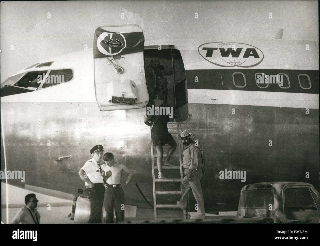 Nov. 11, 1970 - Some of the passengers boarding the hijacked Twa plane which landed in the Jordanian desert. The popular front flag is seen in front of the plane.The passengers of the three planes were moved to Amman. - Stock Image