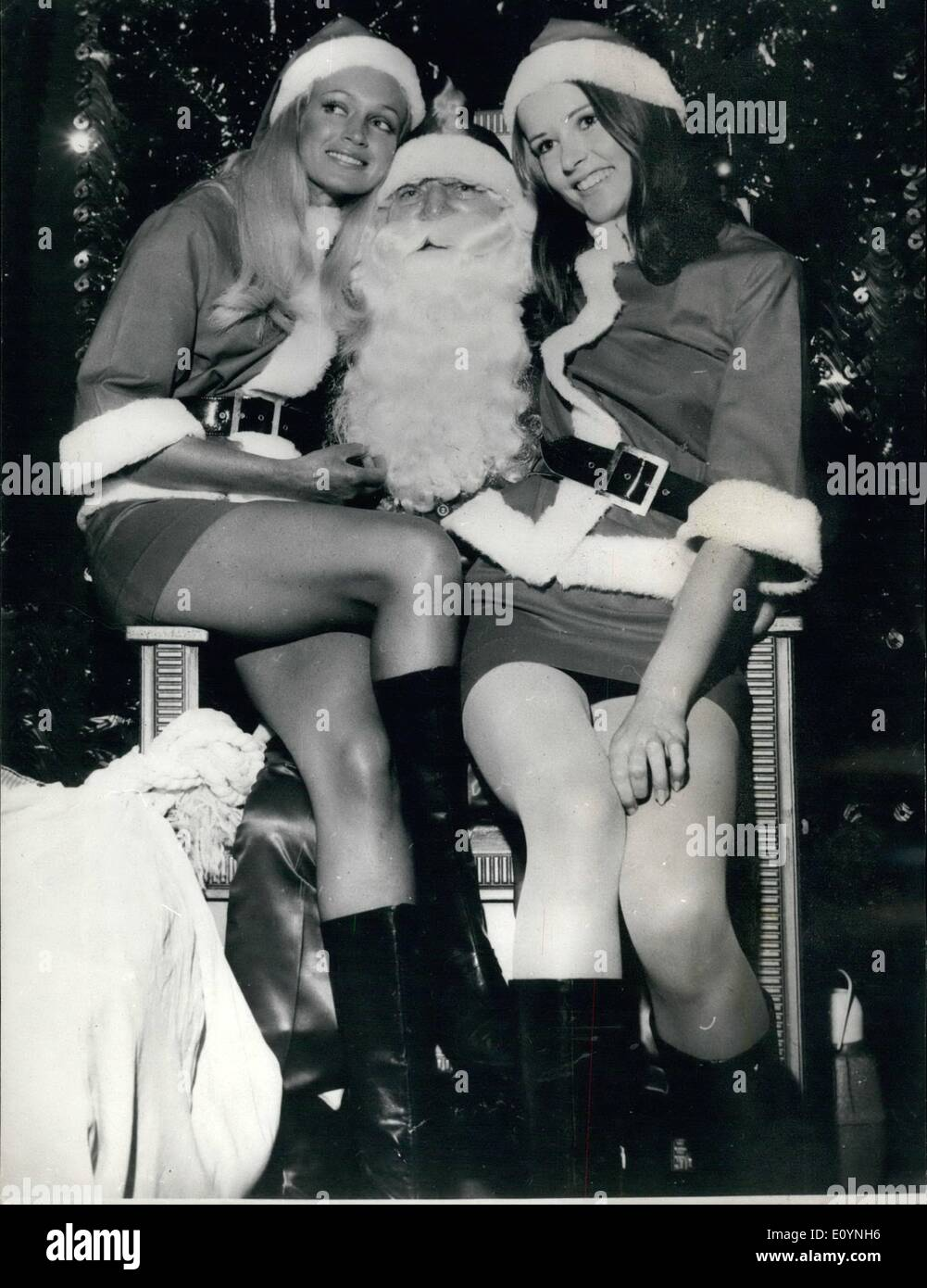 Dec. 12, 1970 - Big Girls Like Santa Too: Christmas 1970 style is a mini-splendoured thing. When Santa arrived at a city store there were no sleighs drawn by reindeer - but there were Santa-maids Virginia Foot (left) and Sue Jackson. - Stock Image