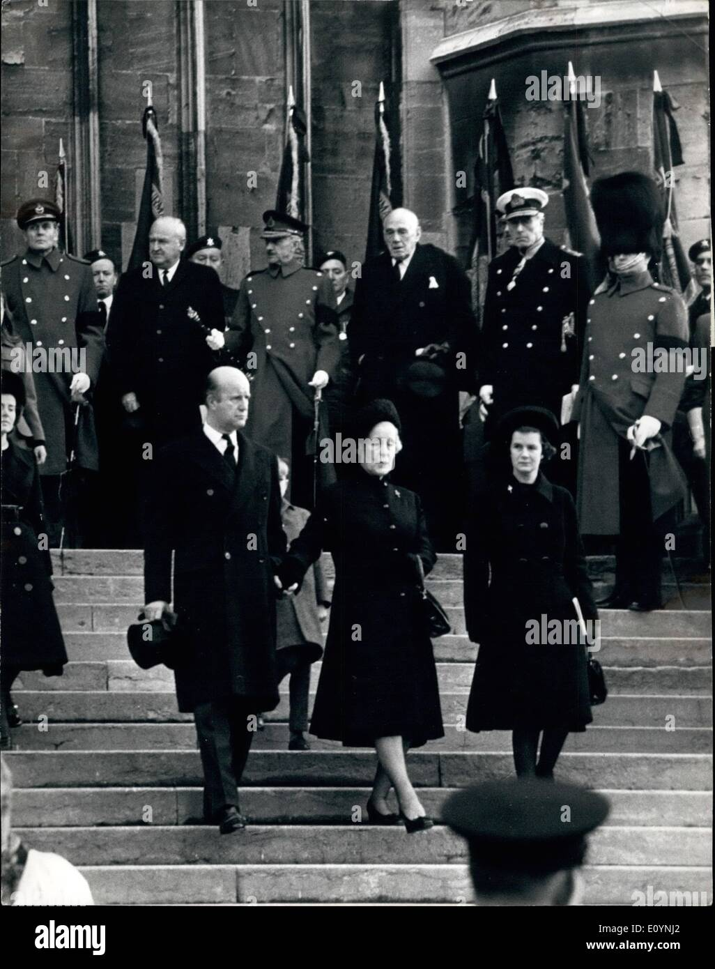 Dec. 12, 1970 - Full Military Honours For Lord Slim: Windsor, England Lady Slim (second from right, fore-ground) wife of the late Field Marshal Lord Slim, slowly descends the steps of St. George's Chapel, Windsor Castle here today after attending the funeral service for her husband who died on December 14th. Lady Slim is flanked by her daughter (on right) and her son, the new Lord Slim. Behind her (second from right, back-ground) is the Earl Mountbatten of Burma. Field-Marshal Viscount Slim was afforded full military honours - Stock Image