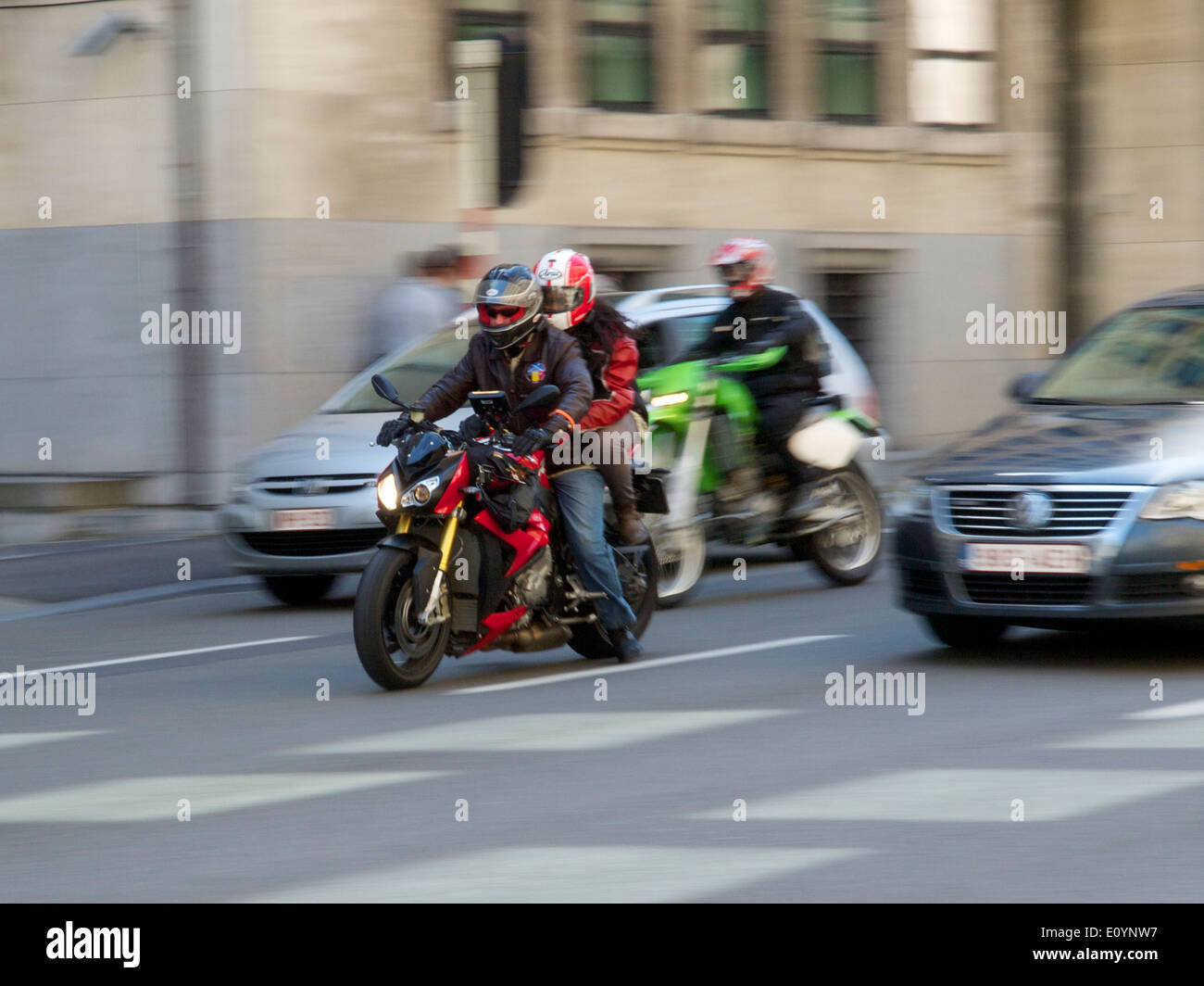 Commuting by motorcycle on the wetstraat in Brussels, Belgium, one of the most congested cities in Europe - Stock Image