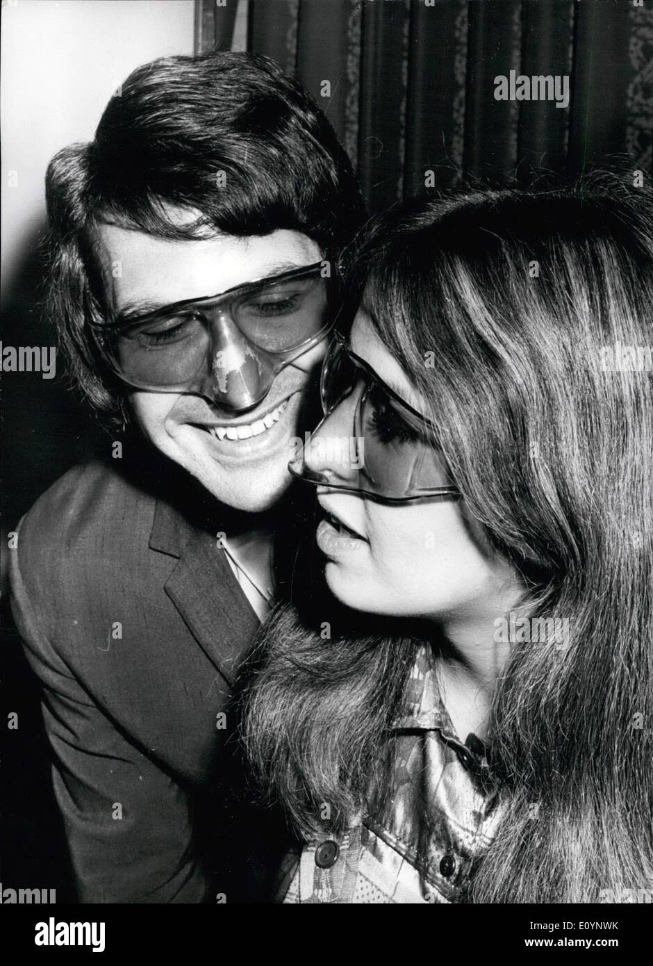 Jan. 01, 1971 - Sunglass Fair  Photo Shows: Ray Goldsmith and Lynn Oakley wearing the latest in sunglasses - The Nosegua - Stock Image