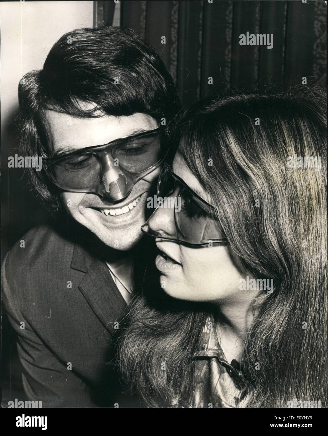 Jan. 01, 1971 - Sunglass Fair.: Photo Shows Ray Goldsmith and Lynn Oakley wearing the latest in Sunglass – The Noseguard - Stock Image