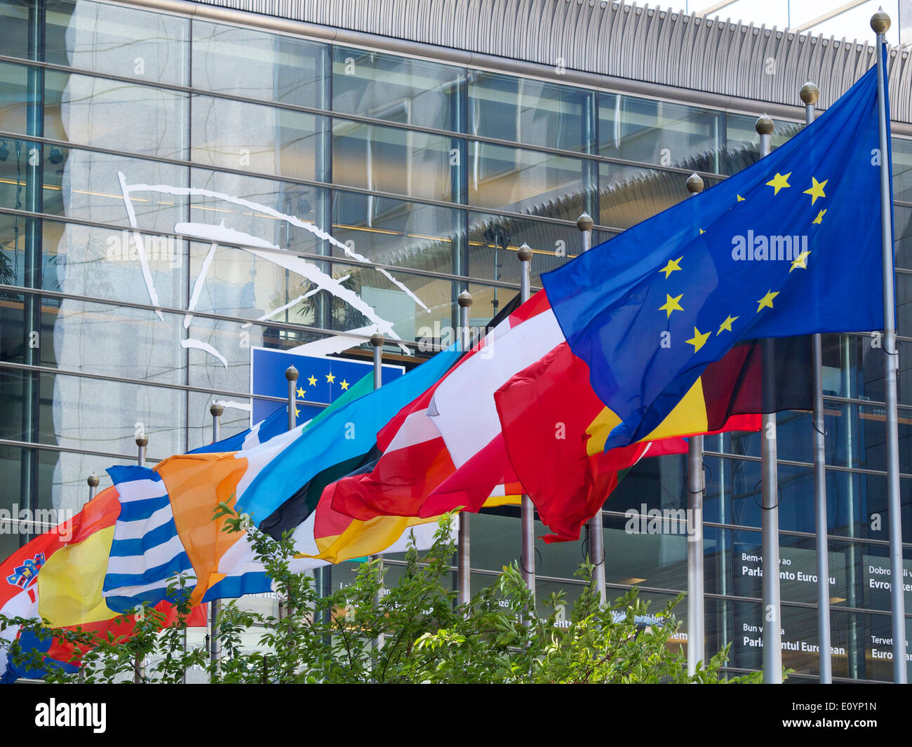 nationalRow of various European national flags at the EU parliament building in Brussels, Belgium - Stock Image