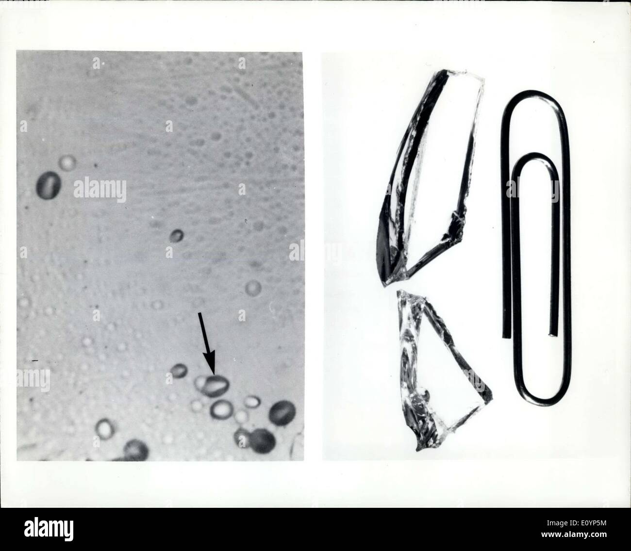 Jan. 15, 1971 - Left: Fragments from a chunk of glass that spent 31 months on a moon aboard the Surveyor III spacecraft have revealed new clues to the rate at which lunar rocks are undergoing erosion. By studying cosmic ray tracks (arrow-right) that accumulated in the glass during its stay on the moon, scientists at the General Electric Research and Development Centre have calculated that particles from space are wearing away the moon's rocks at a rate of about one layer of atoms per year. At this rate, it would take 60 million years to wear away one half inch of rock - Stock Image