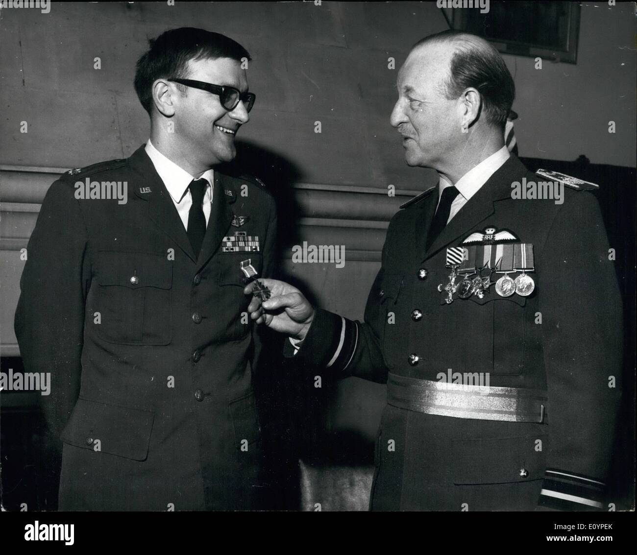 Feb. 03, 1971 - February 3rd, 1971 American D.F.C. presentation. Photo Shows: Air Vice Marshal L.H. Moulton, Air Officer Commanding 90 (Signals) Group, Medmenham, Bucks, presenting the American D.F.C. at the R.A.F. station yesterday, to Major James G. Jones, 36, USAF, for services as an electronic warfare officer in Vietnam. Major Jones is at present an exchange officer at Medmenham. - Stock Image