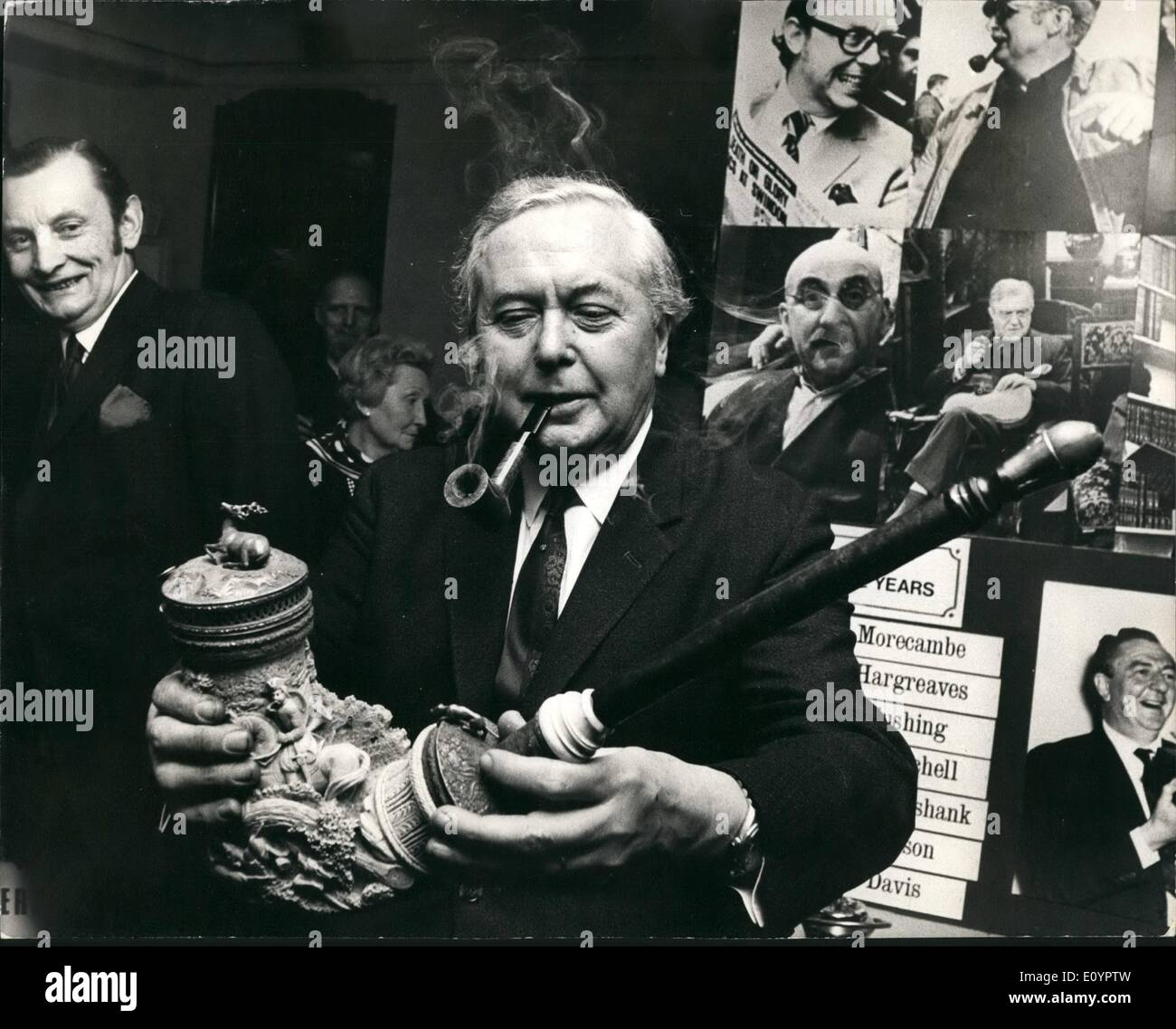 Mar. 03, 1971 - Mr. Wilson at ''pipe Smoking through the ages'' exhibition. Mr. Harold Wilson today opened the ''pipe smoking Through the ages'' Exhibition - in park lane. Photo shows Mr. Wilson puffing contentedly at a pipe which was presented to him at today's opening -as he inspects one of the exhibits - a Meerschaum pipe made for the great Exhibition of 1851. - Stock Image