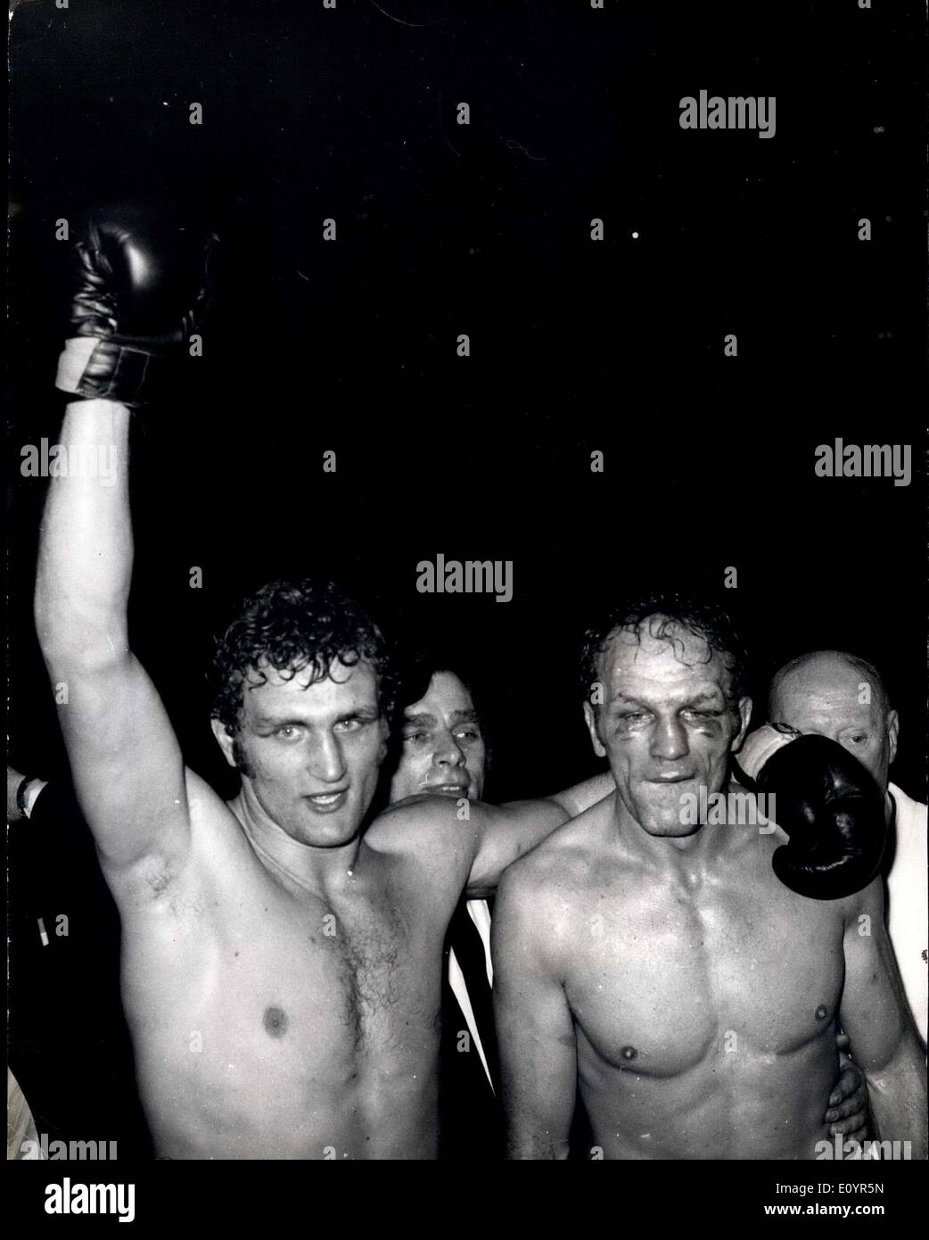 Mar. 17, 1971 - Joe Bugner is the new champ: 21 year old Joe Bugner last night became the British, Commonwealth and European heavyweight champion when he beat Henry Cooper on points over 15 rounds at Wembley. After the fight Henry Cooper, 36, announced that he will retire from the ring. Photo shows Joe Bugner, with raised arm, and Henry Cooper, pictured after last night's fight. - Stock Image