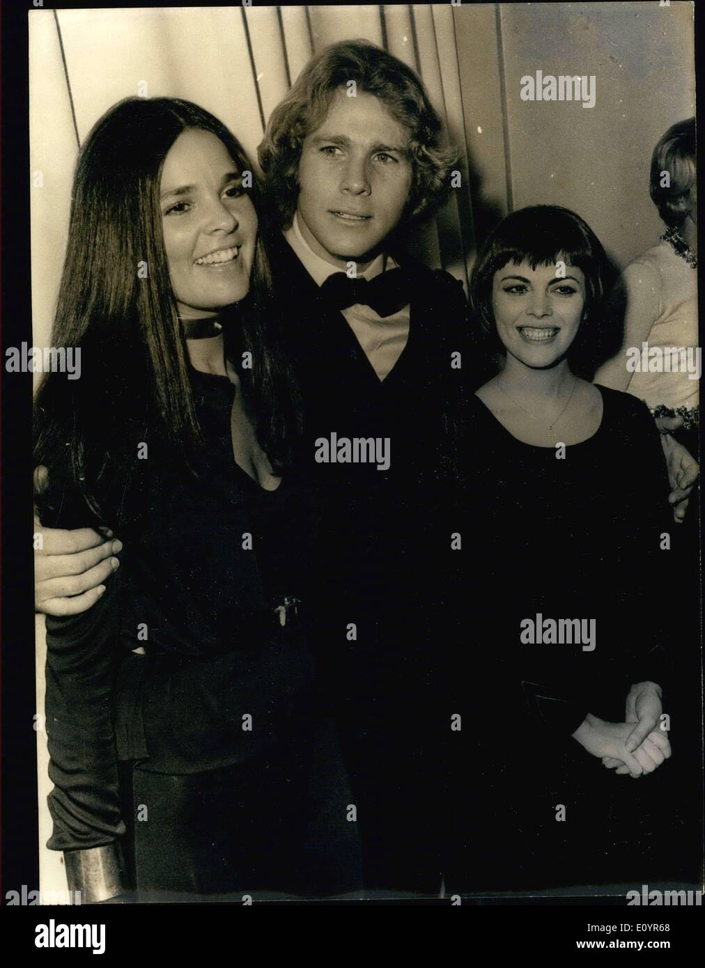 Mar. 20, 1971 - The stars of the movie, ''Love Story,'' Ryan O'Neal and Ali MacGraw are seen here with Mireille Mathieu at the movie's premiere Champs-Elysee Theater. - Stock Image