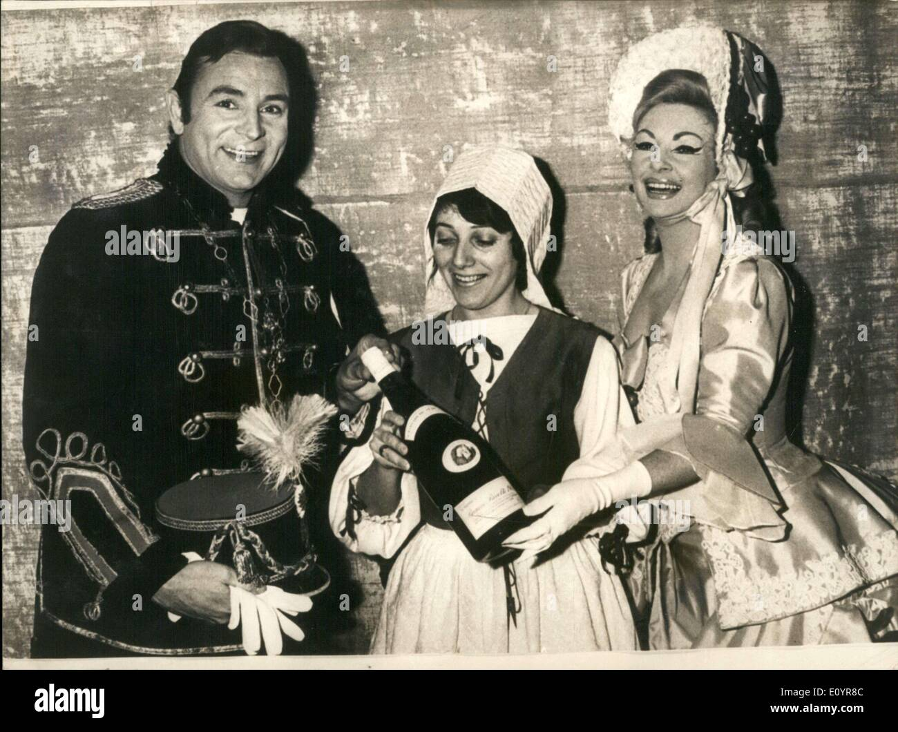 Mar. 29, 1971 - The opera's title is ''Come Sing and Dance'' and it has been shown in France 1,000 times even though it was only written 5 years ago. The 1,000th show was held in Dijon. A woman is seen here presenting the two singers with a bottle of wine. - Stock Image