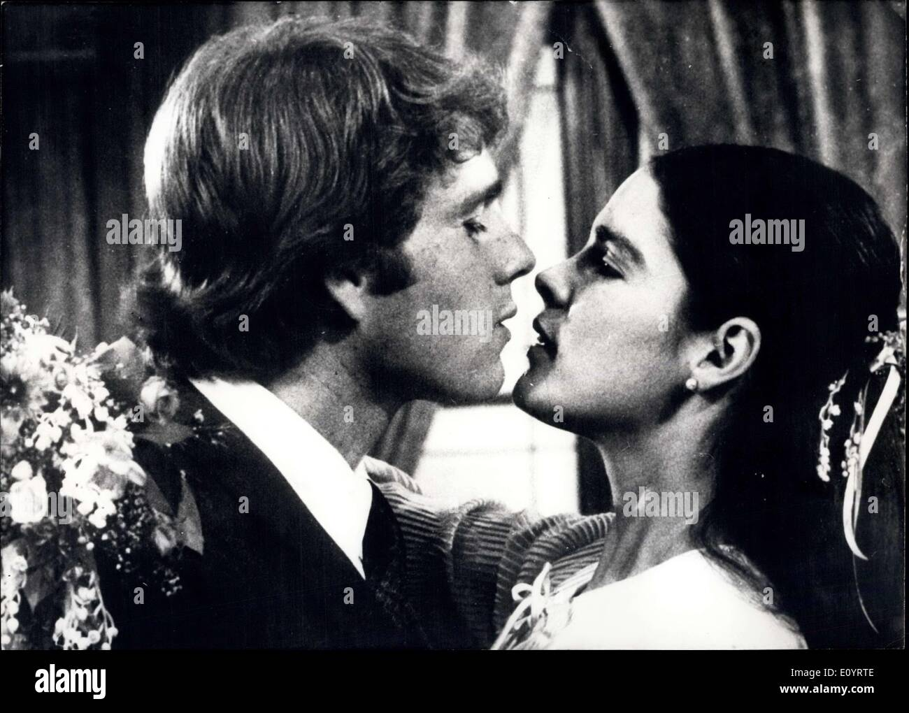 Apr. 23, 1971 - Love Story'' film of the year: The film which is to be the most lucrative one of all times and is even to outrun the best film so far ''Gone by the wind'' is simply called ''Love Story''. 'Love Story' is the story of a young man who marries an Italian girl against the will of his father. She has to die in a tragic way and dies in his arms. Besides the memories he has only a ticket to Paris and much money of his rich father who forgives him, no, after his wife has died - Stock Image