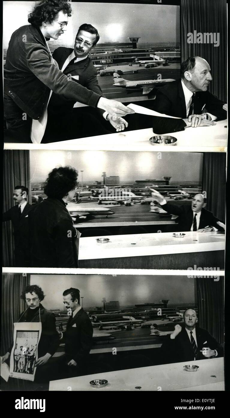 Jun. 06, 1971 - Demonstrator Angers Mr. Luns: During a Press conference he gave on arrival at Schipel Airport, Amsterdam from New York yesterday, Mr. Luns, the Dutch foreign Minister, who will be secretary-general of the NATO Oct 1st. 1971 - was angered when a member of the Angola-committee, who protest against the attitude of Mr. Luns in respect of the Portugal Government's colonial politics, entered the Press room and banded a manifesto to Mr. Luns. Photo shows (Top Picture): The demonstrators hands the manifesto to Mr. Luns, who later crushed it; (Middle Picture): With outstretched hand Mr - Stock Image