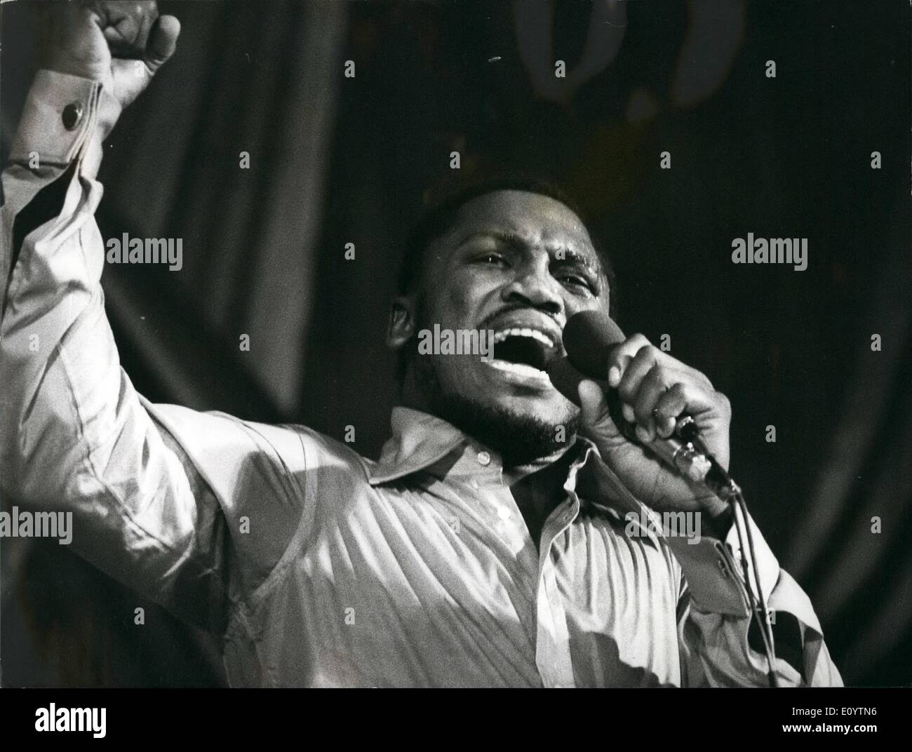Jun. 06, 1971 - Joe Frazier Sings: Photo Shows World Heavyweight boxing champion Joe Frazier, pictured on stage during his singing appearance at the Granada Theatre, Tooting, last night. He supported by his musicians, The Knockouts. - Stock Image