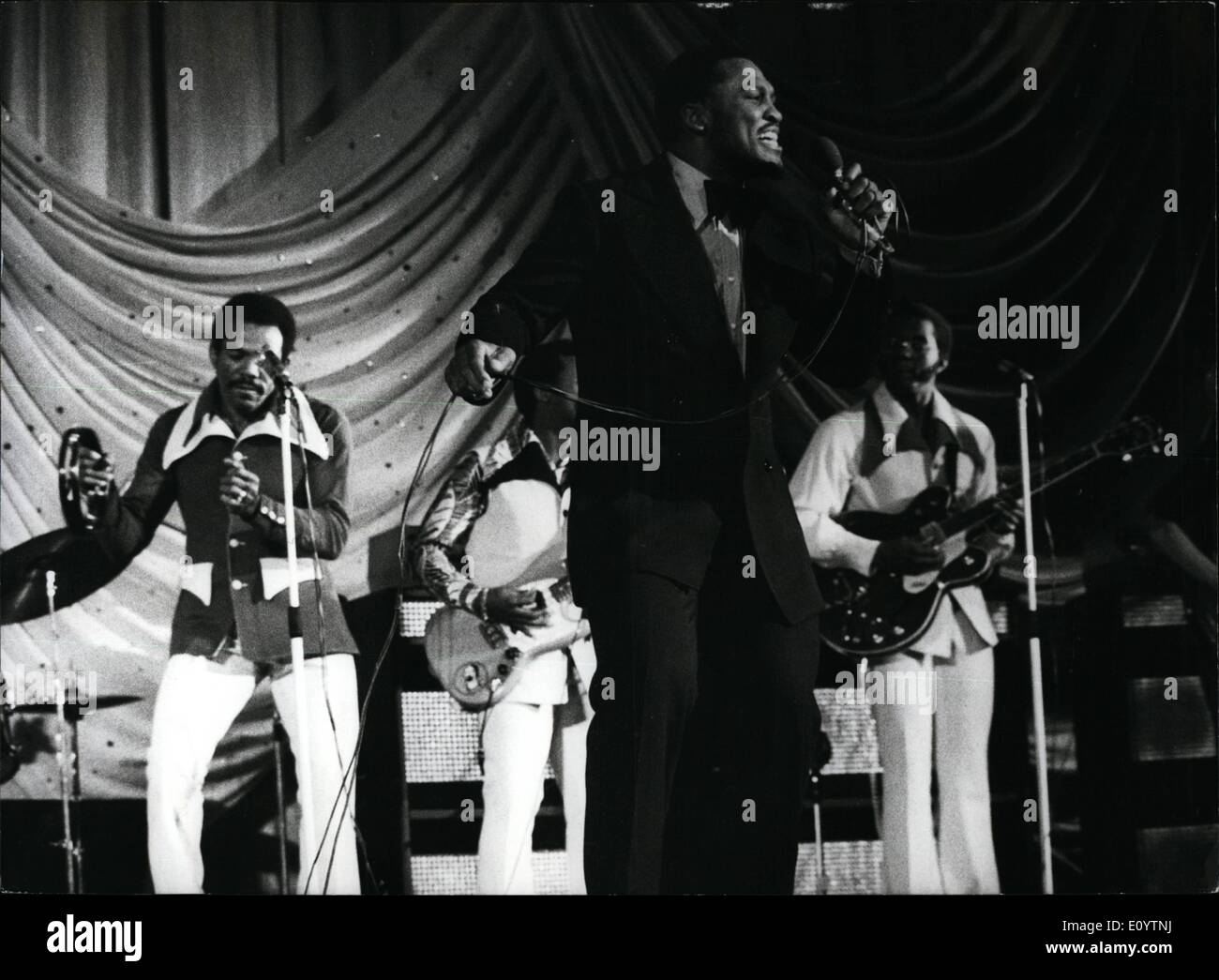 Jun. 06, 1971 - Joe Frazier sings. Photo shows World heavyweight boxing champion Joe Frazier , pictured on stage during his singing appearance at the Granada Theatre, Tooting last night. He was supported by his group the Knockbuts. - Stock Image