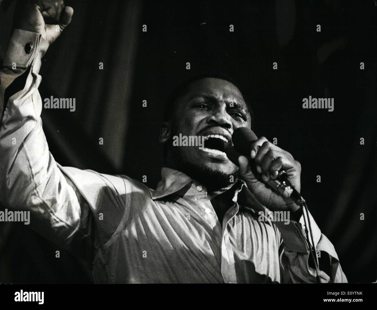 Jun. 06, 1971 - Joe Frazier Sings. World heavyweight boxing champion Joe Frazier, pictured on stage during his singing appearance at the Granada Theatre , Tooting, last night . He was supported by his musicians. - Stock Image