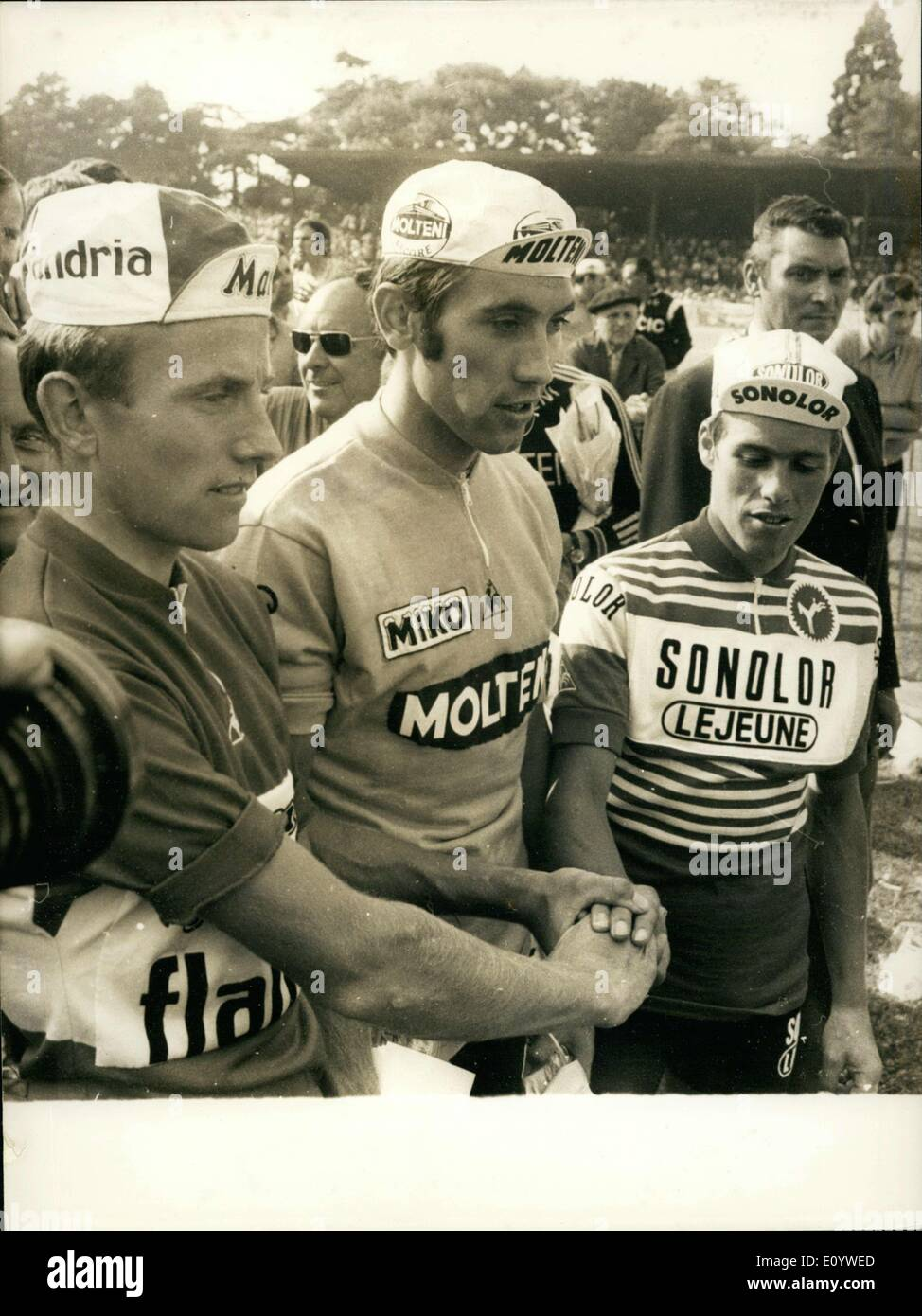 Jul. 19, 1971 - Eddy Merckx's Tour de France race finished with a new record performance that would win the last leg of the race to Versailles. Pictured here is Holland's Zoetemelk (left), 2nd place; Eddy Merckx, 1st place; and Belgium's Lucien van Impe, 3rd place. - Stock Image