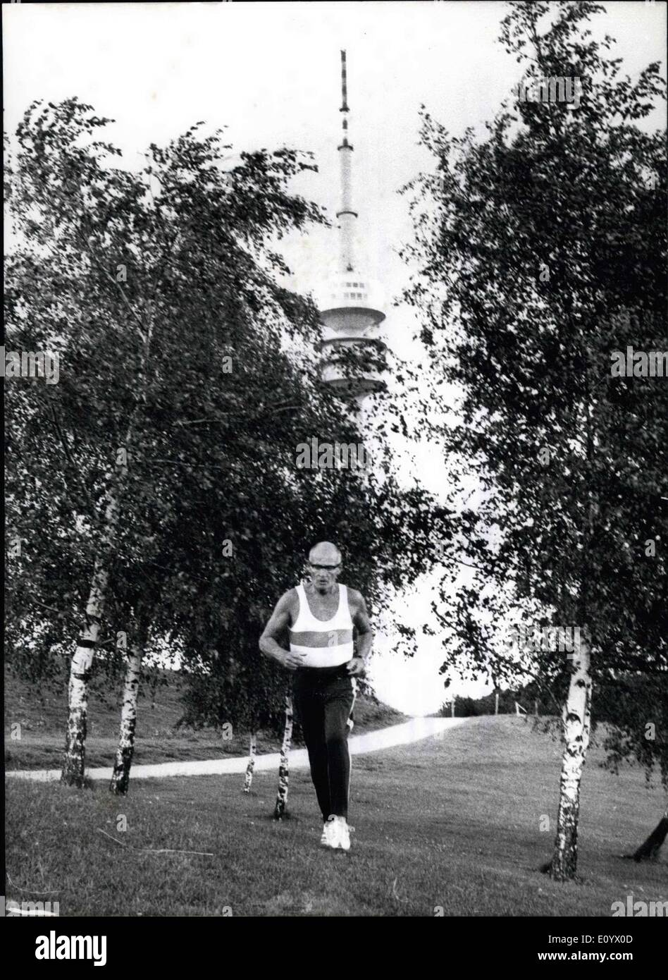 Aug. 31, 1971 - 70-year-old man 'Trains'' for the Olympic Torch-run: For the Olympic Games 1972...Hans-Werner von der Planits is ''training'' for a long time already. The 70 years old doesn't want to become active in the Olympics, but he is the responsible organiser of the Olympic Torch-run 1972. Therefor time of his lunch-break for running. He runs up the Olympic Hill, down again and then around it, always about five or six Kilometers - Stock Image