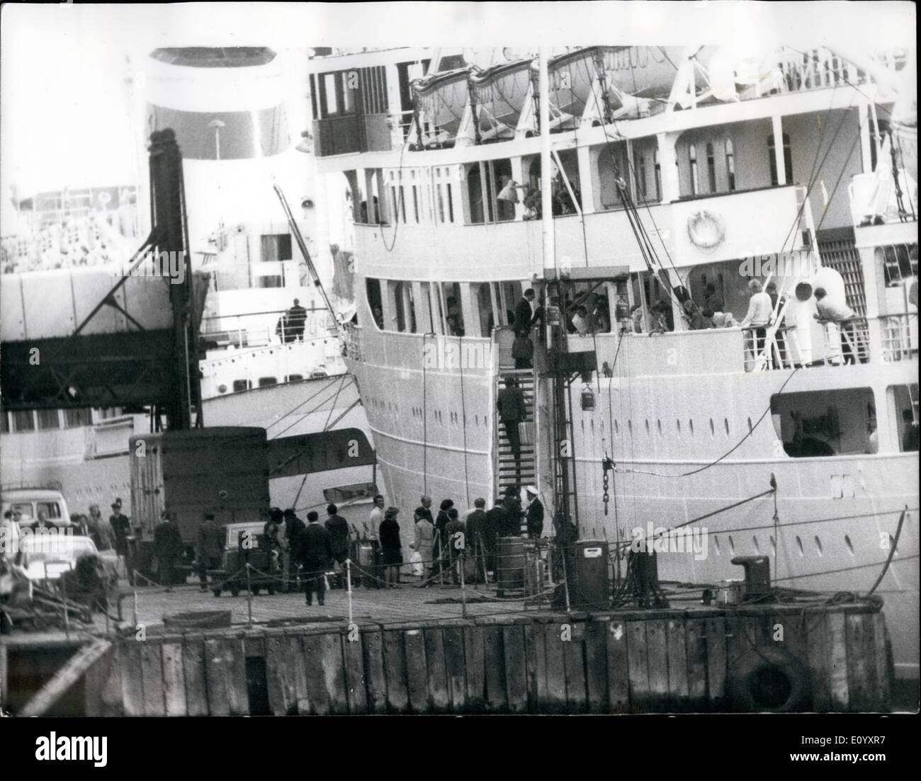 Oct. 10, 1971 - SPY RUSSIANS SAIL HOME IN CRUISE LINER. About 70 of the 90 officials expelled by Britain for spying sailed home yesterday in a Russian cruise liner commandeered by the Soviet Embassy. It was the 8,486-ton Baltika, which left Tilbury. Photo Shows:- Homeward bound - Russians expelled in the British government's spy purge - boarding the cruise liner Baltika, which sailed from Tilbury yesterday. - Stock Image