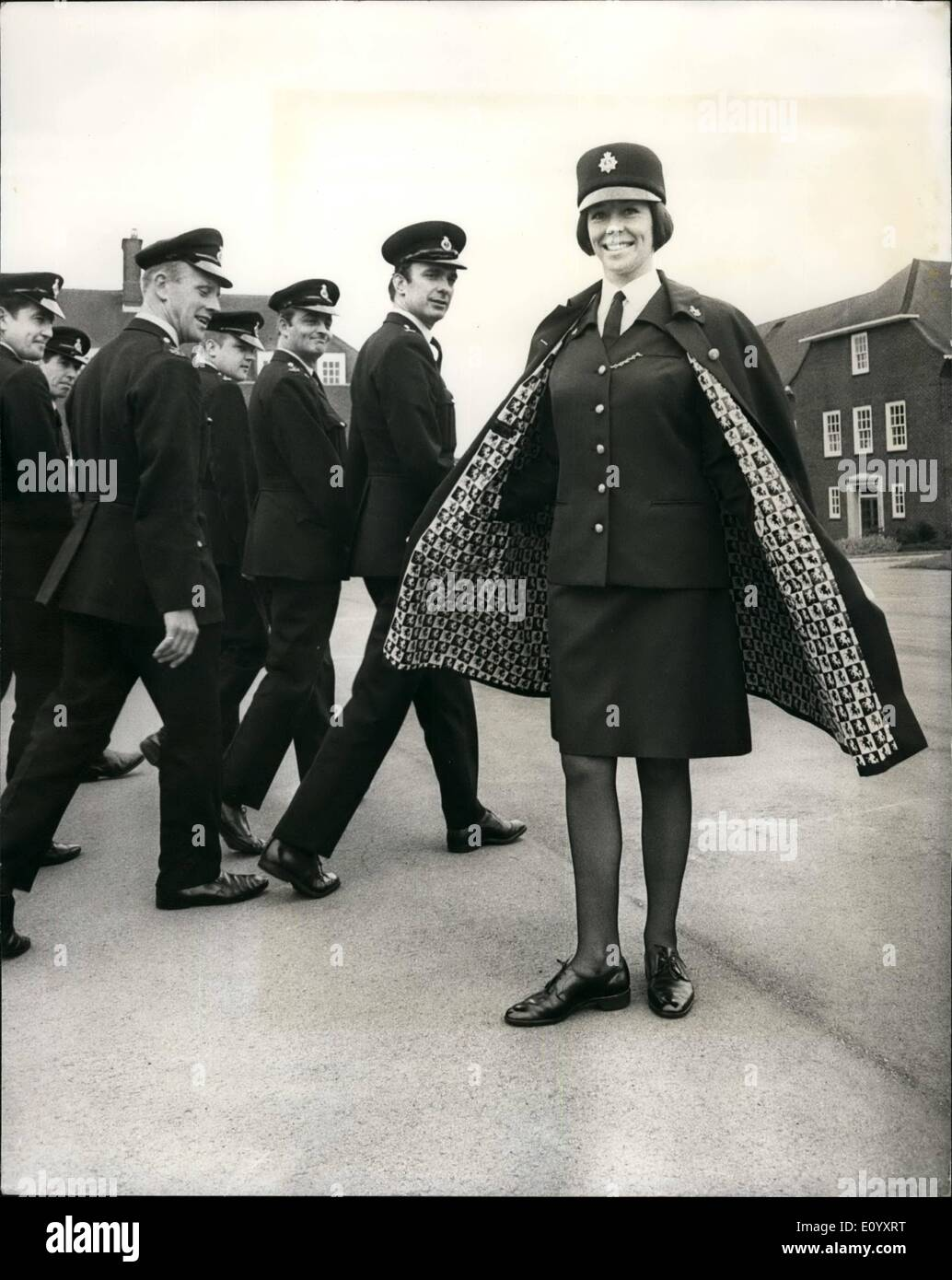 Oct. 10, 1971 - New style uniform for Kent women police; Women officers and girl cadets in the Kent police force will have a new style uniform from next April when the present uniforms, adopted in 1961, will be phased out. The new uniform will be issued to be phase out. The new uniform will be issued to recruits and girl cadets on enrollment but serving policewomen will receive the new uniform as their existing garments become unserviceable. The new uniform is 55% terylene and 45 % wool worated. The uniform, which includes a full length cape, has been designed by Miss J. Moore - Stock Image