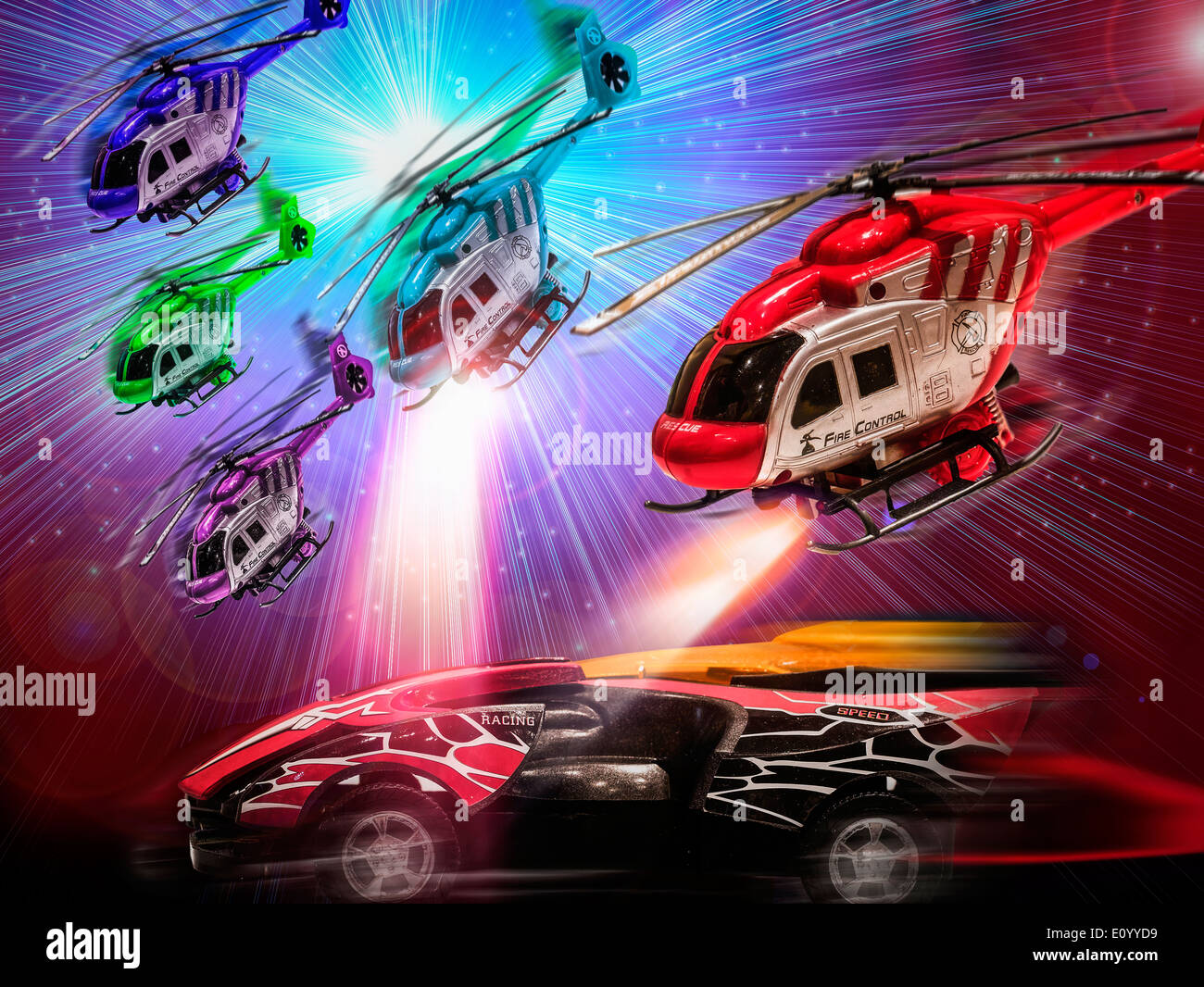 Toy Helicopters Chasing a Toy Car - Stock Image