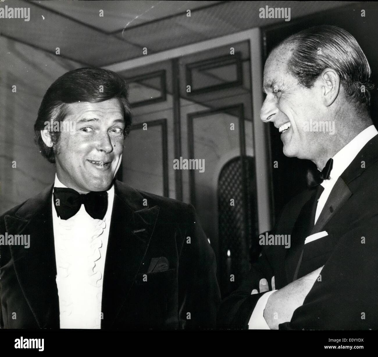 Nov. 11, 1971 - The Duke Of Edinburgh Meets The 'Saint'. Photo Shows British actor Roger Moore (left) star of the TV series ''The Saint'' shares a joke with the Duke of Edinburgh at the Savoy Hotel, London,in aide of the Variety Club of Great Britain's Fund for Handicapped Children an the Duke of Edinburgh Award. - Stock Image