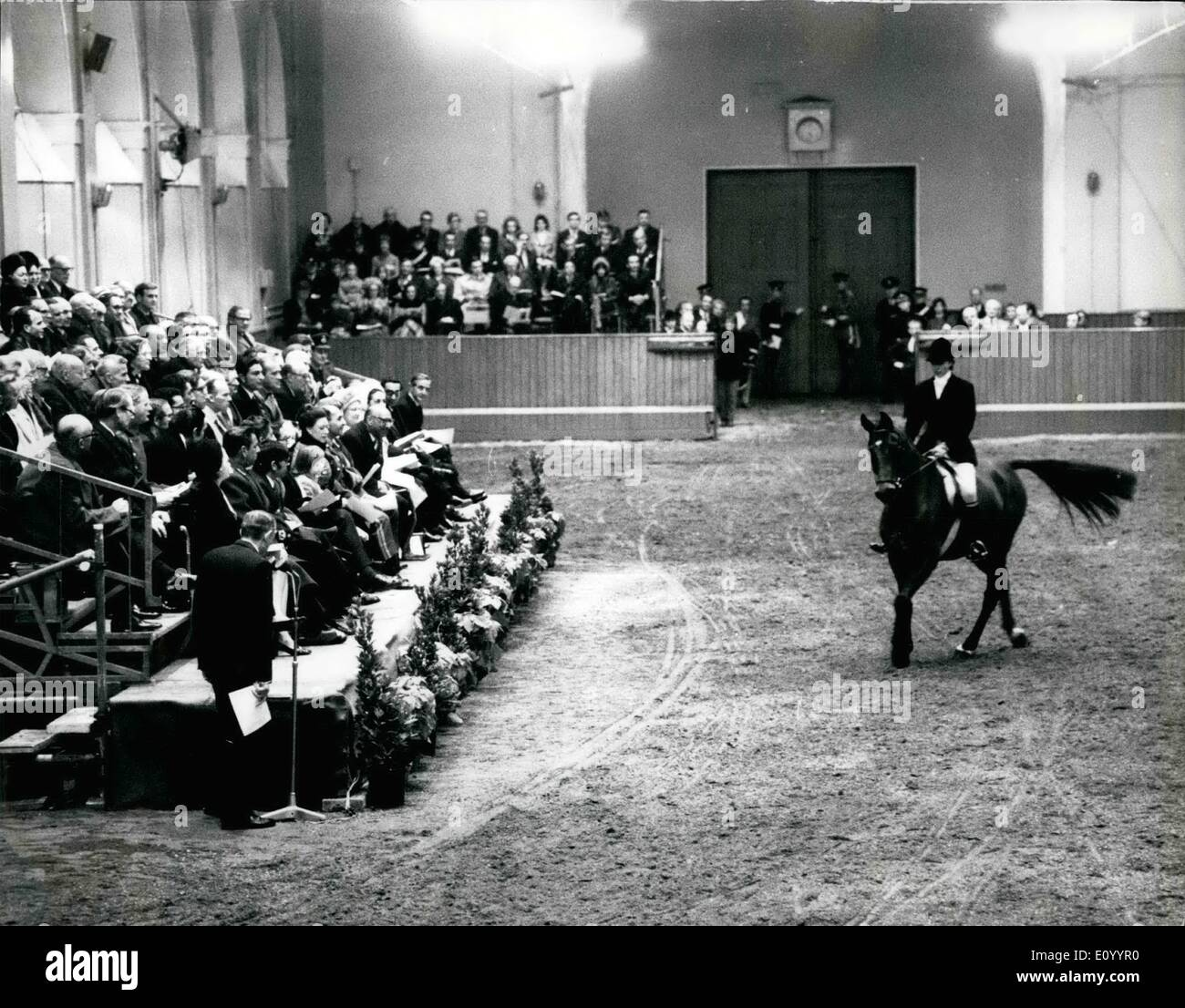 Dec. 12, 1971 - Princess Anne at Royal Horse Show. The Queen and the Duke of Edinburgh , and the King of Afghanistan , with H.R.H. Princess Bilquis saw a display of horses in the Riding School of the Royal Mews at Buckingham Palace last night. Climas of the display was Princess Anne who rode into the arena. Photo shows Princess Anne riding into the arena last night. The Royal Box with the King of Afghanistan , H.M. Queen Elizabeth II and other members of the Royal family is on the left. - Stock Image