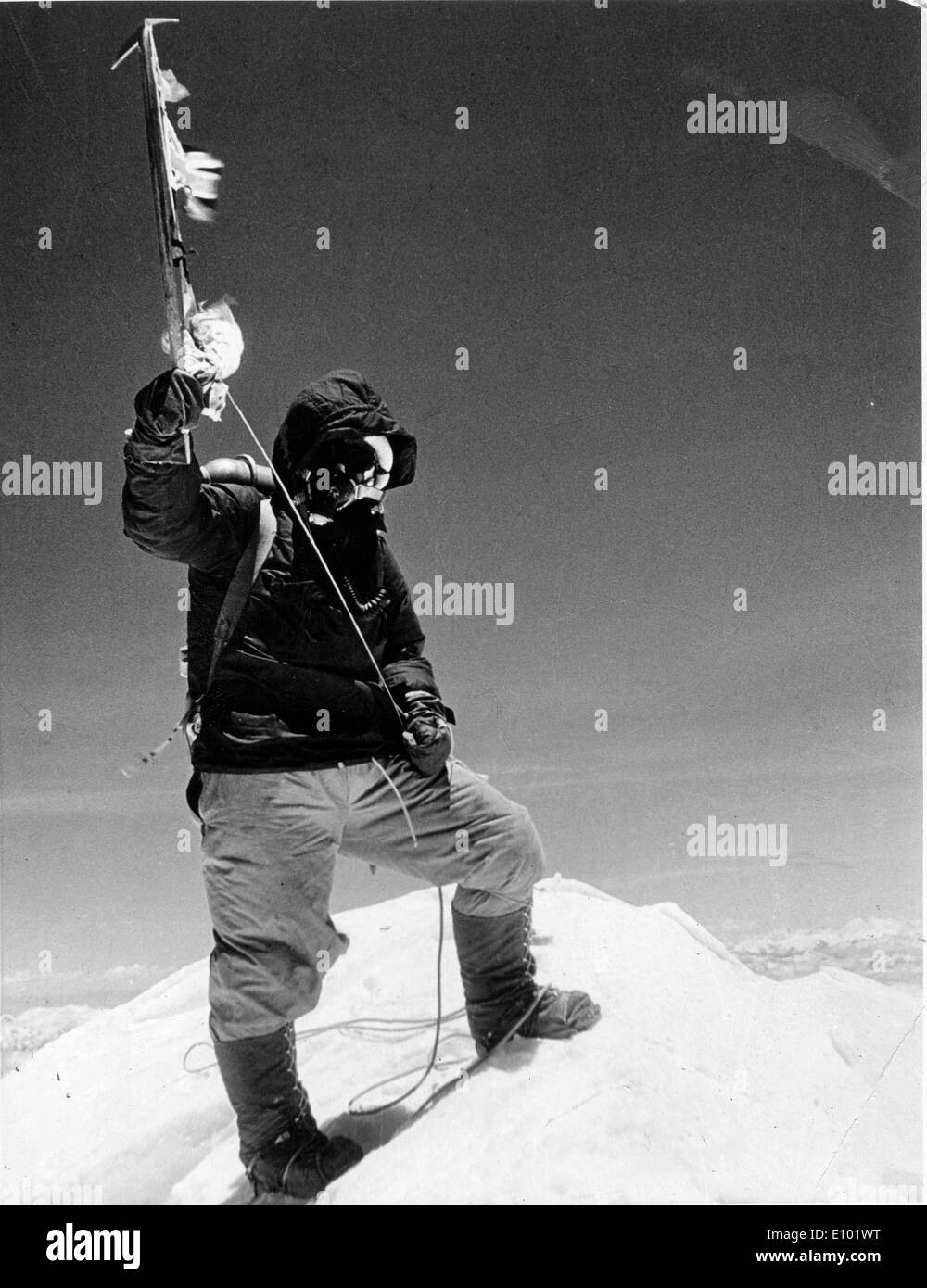 MOUNT EVEREST explorer holding an icy pick ax attached to a rope - Stock Image