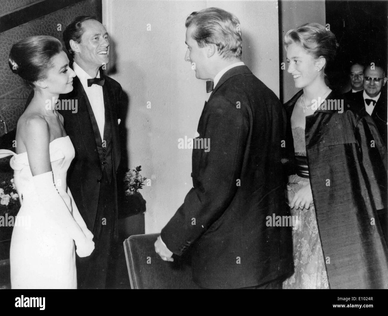 Actress Audrey Hepburn chats with Belgium royalty - Stock Image