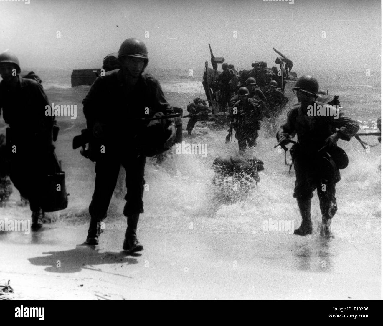 Soldiers on the beach and surf during World War Two Pacific Theater. - Stock Image