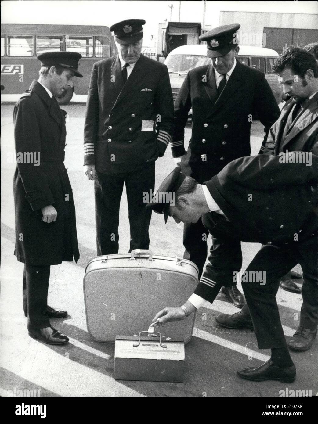 Feb. 02, 1970 - Luggage Identified by passengers before going aboard Airliner: Baggage was identified by passengers at Hearthrow yesterday before being taken aboard a BEA Trident bound for Athens and Tel Aviv. The luggage had been off-loaded from another Trident when the pilot, Captain James Bell, decided not to take off because the Earl and Countess of Gainsborough had refused to fly in the plane. Captain Bell (second from left) is seen watching as unclaimed items were examined. - Stock Image