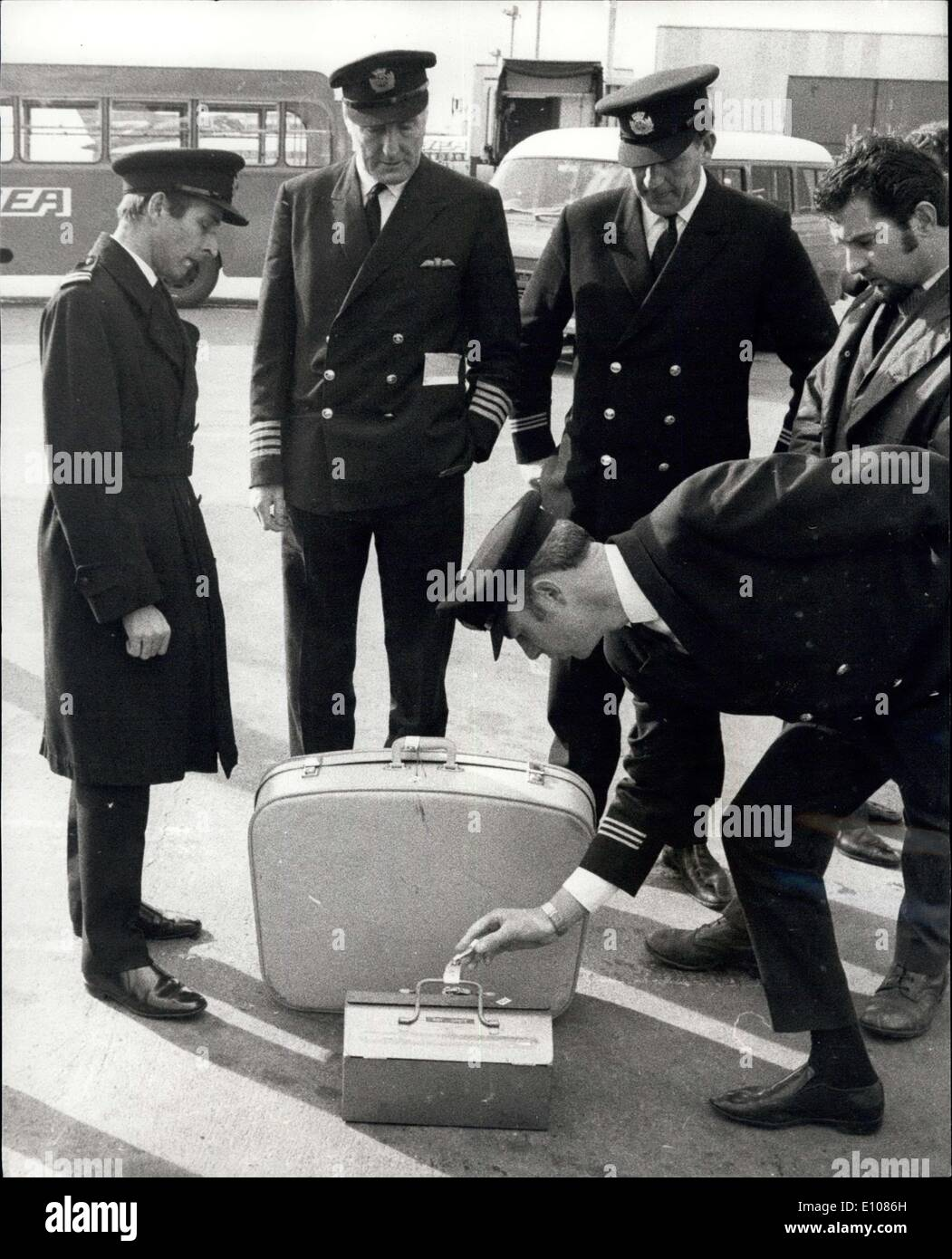 Feb. 25, 1970 - Luggage identified by passengers before going abroad airliner.: baggage was identified by passengers at Heathrow yesterday before being taken aboard a BEA Trident bound for Athens and Tel Aviv. The luggage had been off-loaded from another Trident when the pilot, Captain James Bell, decided not to take off because the Earl and Countess of Gainsborough had refused to fly in the plane. Captain Bell (second from left) is seen watching as unclaimed items were examined. - Stock Image