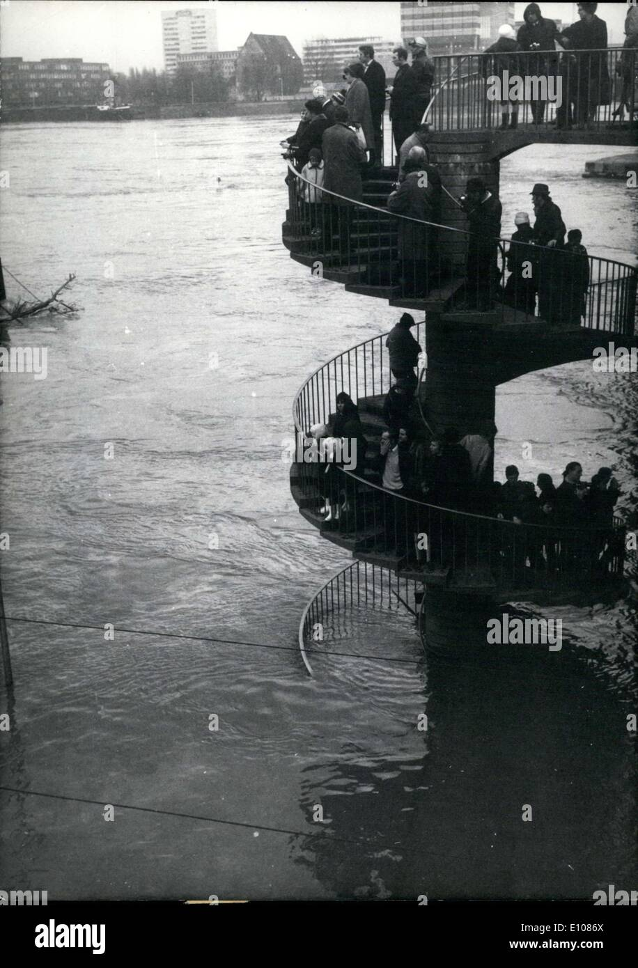 Feb. 26, 1970 - Pictured here are some Koeln resident as they look down at the high water of the Rhein river on the Deutzer Bruecke. The river water level had raised drastically in many parts of Germany and the water had taken over many streets(pictured here is Rheinuferstrasse).Over 1,000 policemen, Armed Forces soldiers, firemen, and civil service members were fighting the flooding. - Stock Image