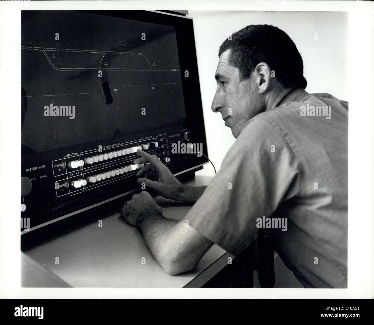 May 26, 1972 - Computerized People Movers: Wayne Bales Programs the computerized''people mover'' system built by the Bendix Corporation for Transpo 72 May-27 - June 4 at Dulles International Airport. The System's vehicle are routed to their destinations by the computer, which decided the fastest, safest route. Passengers summon a vehicle and direct it to their destination by pressing buttons in much the same way an elevator is operated. - Stock Image