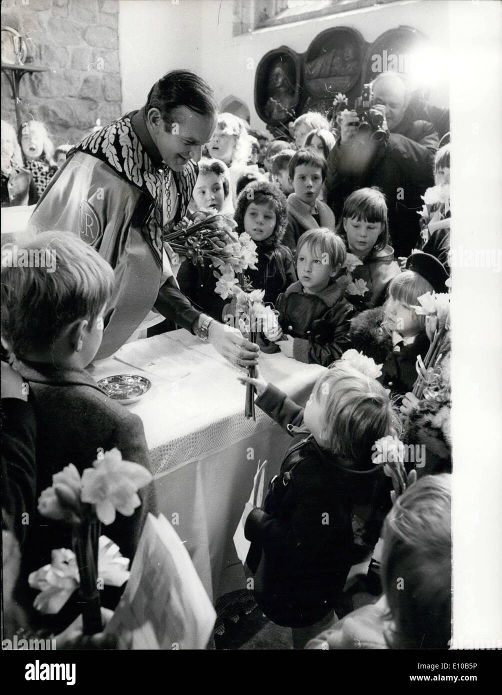 Mar. 03, 1972 - Mothering Sunday Service: The Rev. John Nicholls, the Queen's Chaplain to the Tower of London, handing members of his Congregation tokens of Spring and Mothering Sunday which they took them after a service commemorating a thousand-year-old custom at the Chapel Royal of St. Peter and Vincula yesterday. - Stock Image
