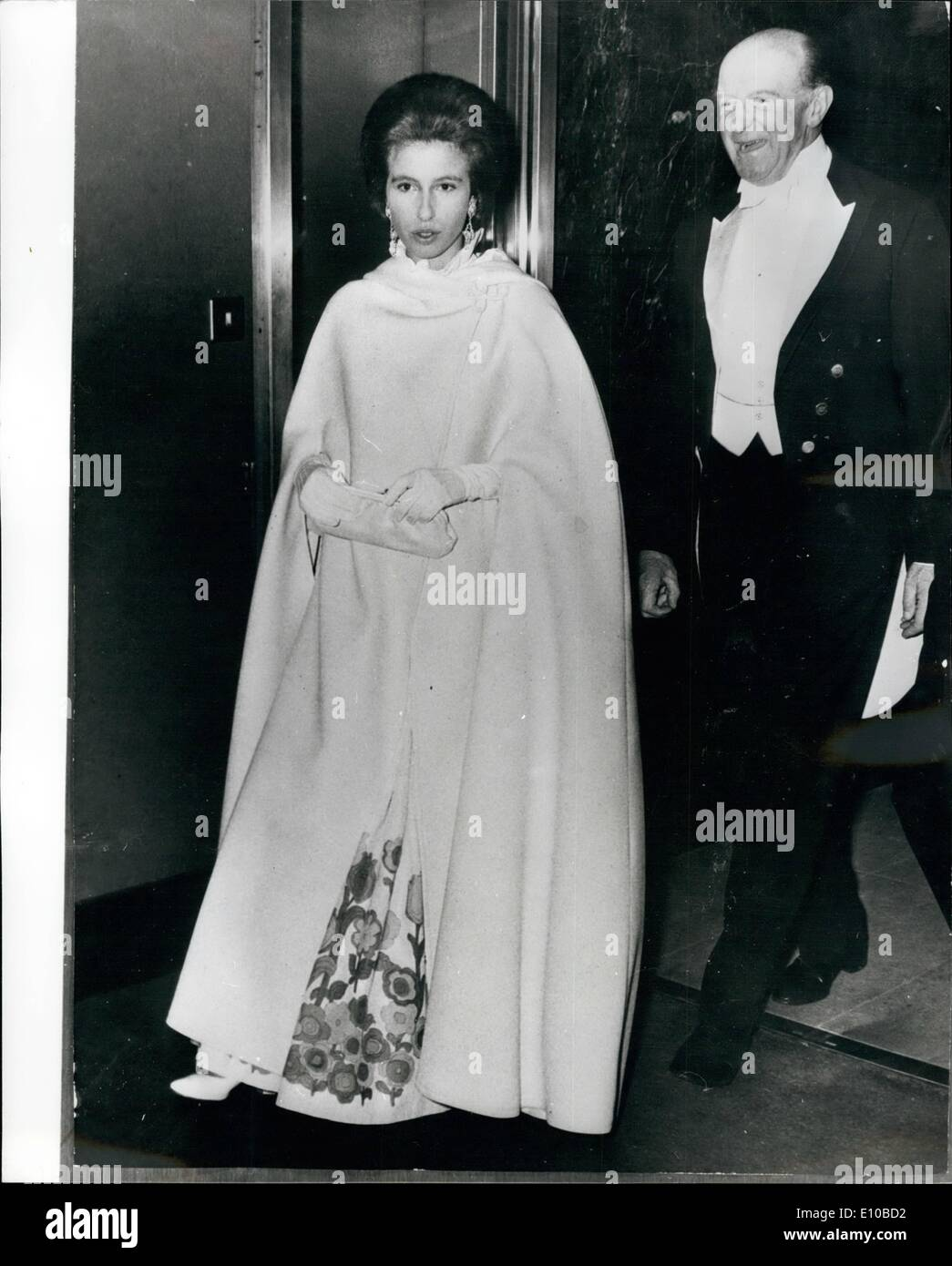 Mar. 03, 1972 - PRINCESS ANNE AT BAIL After being welcomed by The Duke of Beaufort, Princess Anne, wearing a somewhat dramatic Oloak over a floral gown, enters Grosvenor House, London, last night, to attend the ''Horse and Hounds'' dinner and ball. The Princess recently returned home fro. the Far lectern tour where abe had been with the Queen and Prince Philip, who are still abroad, to enable her to prepare for next month's Badminton Horse Trial., at the been of the Duke. of Beaufort, The Trials take on more than usual importence - Stock Image