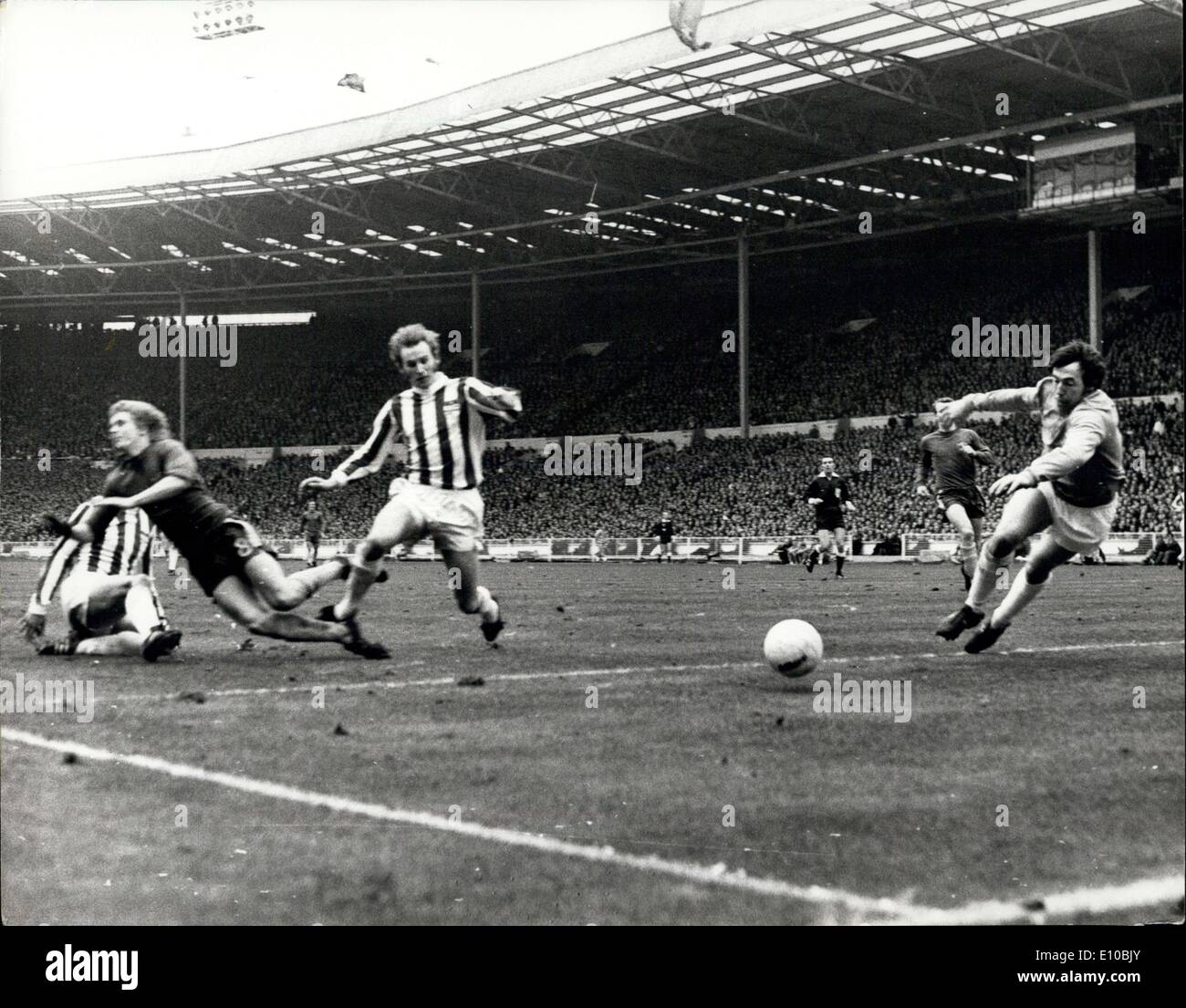 Mar. 04, 1972 - Stock City Beats Chelsea In League Cup Final At Wembley By 2-0. Photo Shows: Chris Garland the Chelsea inside right is sent crashing to the ground by Centre-half Dennis Smith as he shoots wide of Stoke Goalie Gordon Banks. - Stock Image