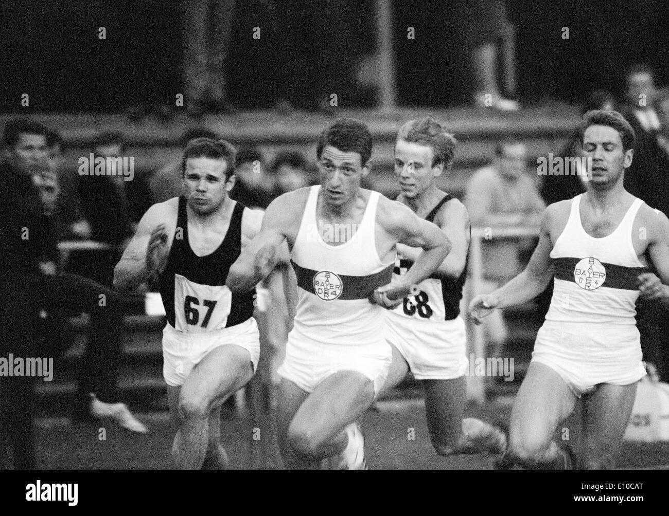 Sixties, black and white photo, sports, athletics, International Meeting in Athletics 1966 in Krefeld-Uerdingen, track racing, sprint, 4 x 100 metres relay, men, changeover, team of Bayer Leverkusen, Johannes Jo Kaiser (2.f.l.), D-Krefeld, D-Krefeld-Uerdi - Stock Image