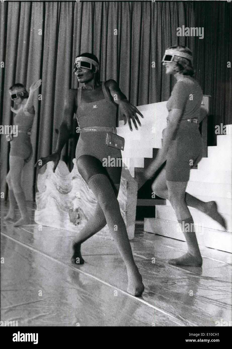 Apr. 04, 1972 - Not for everybody is the new range of the French couturier Andre Courreges shown in Düsseldorf (West - Germany). Only girls with slim legs are able to wear the woollen stockings. New are the sun-glasses to wear with the stockings. To hold the long hair together you use a hair-band with two sun-screens, also designed from Mr. Courreges. - Stock Image