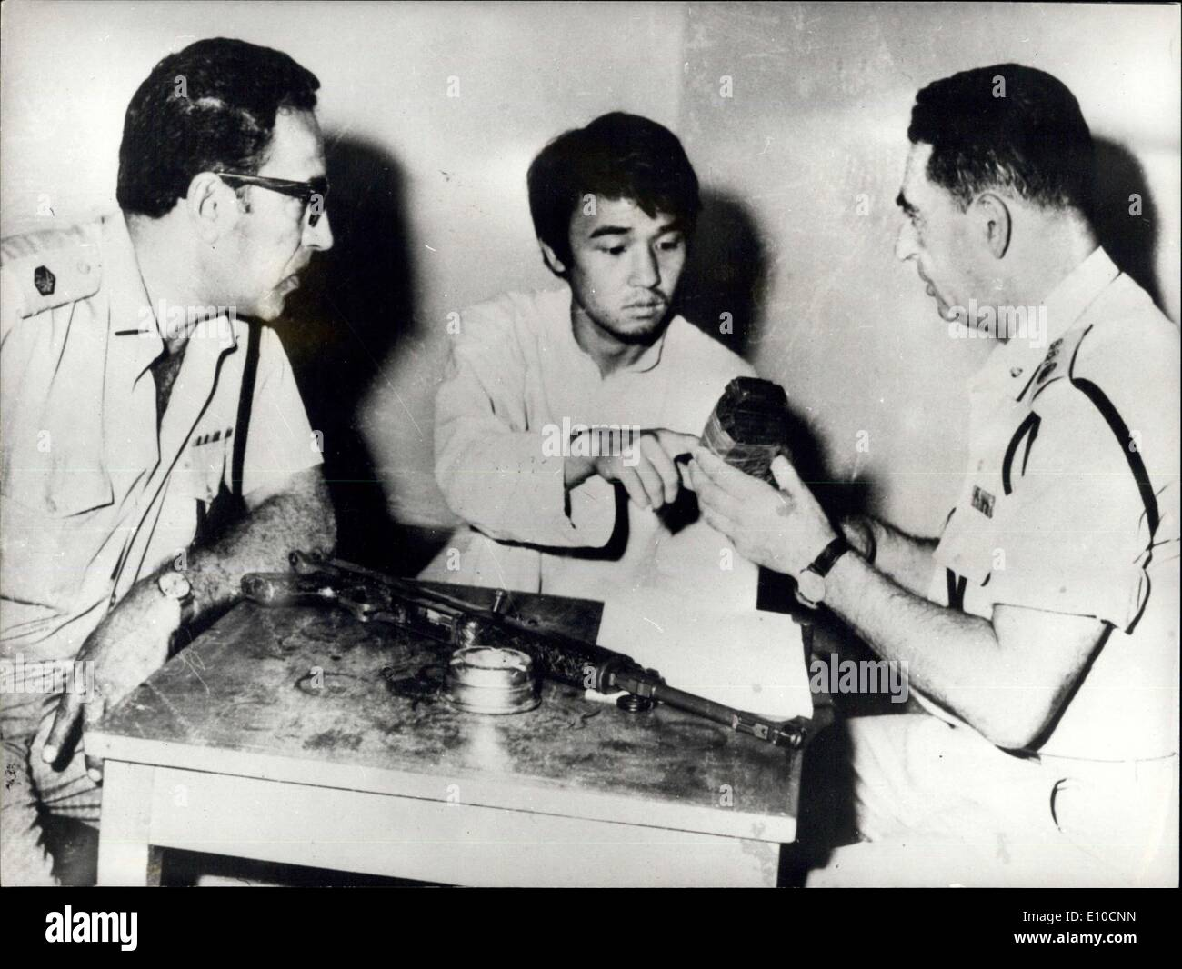 Jun. 19, 1972 - Japanese Survivor of the Three-Man Suicide Squad in the Tel Aviv Airport Massacre is Interrogated: Photo Shows Kozo Okamoto, 24, sole survivor of the three-man Japanese suicide squad which killed 26 people at Tel Aviv Airport a fortnight ago, being interrogated by Israeli police when it was announced that he is to be tried by ab Israeli military court. Before him are some of the weapons used in the massacre. - Stock Image
