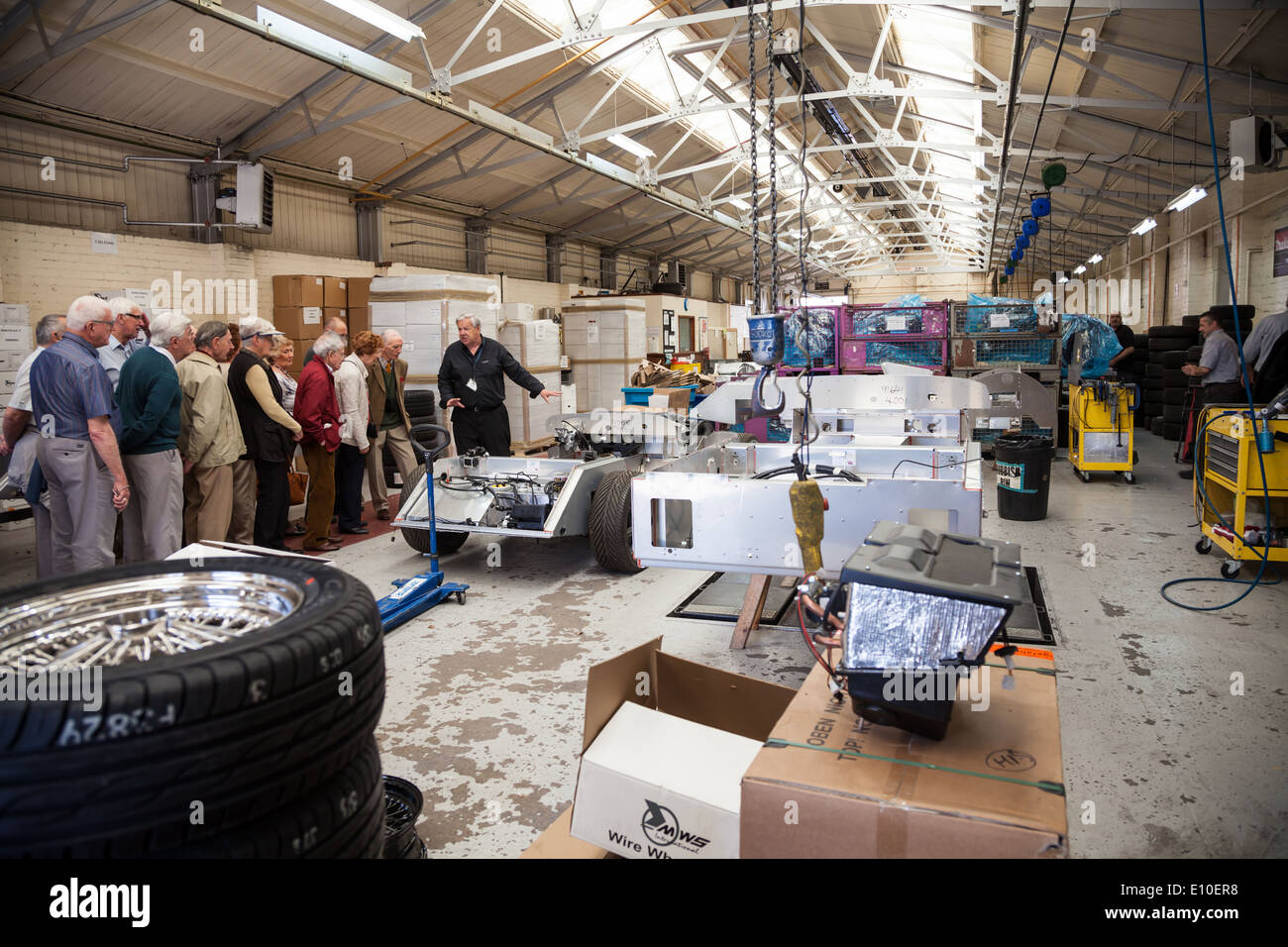 A group of people being shown round the Morgan Motors Car factory - Stock Image
