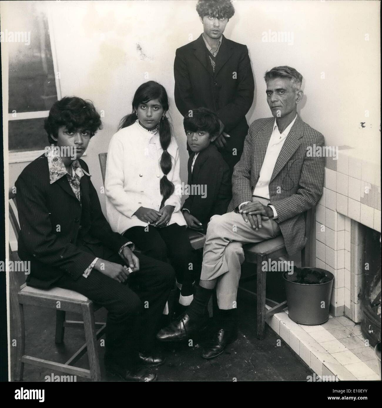 Sep. 09, 1972 - Ugandan Asians ''With nowhere to go'' settle in at RAF Stradishall air - base in Suffolk: The first family to be allocated housing at Stradishall, Suffolk, today, are pictured here around the fire in their new home. Mr. X - he reused to give his name for fear of possible reprisals against other members of his family still in Uganda told how his daughter Jaskree had her necklace taken from her at gunpoint, and cash and rings too, by military police who handled them roughly on the bus from Kampala to Entebbe Airport. Mr X is an accountant - Stock Image