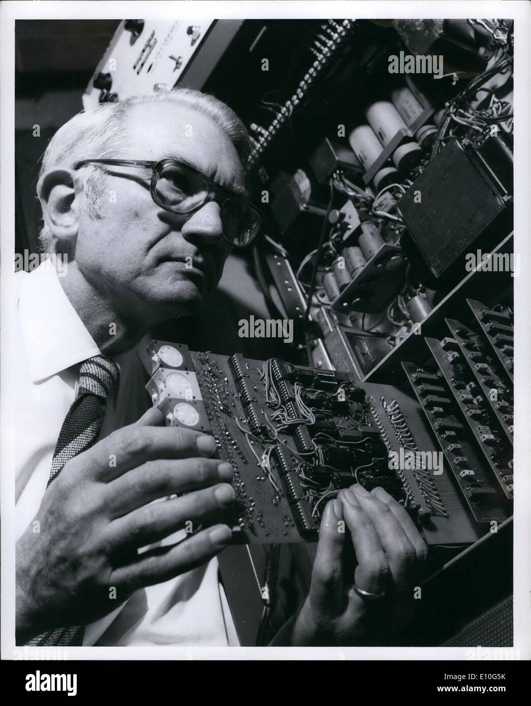 Jan. 01, 1973 - The prototype of an electronic device that will collect data that will aid in the design of a worldwide satellite navigation and communication system is inspected by Roy E. Anderson, a consulting engineer at the General Electric Research and Development Center in Schenectady, N.Y. The ''automatic data collection platform'' will be used to measure strength variations in certain radio signals transmitted from a geostationary space satellite. Mr. Anderson is holding part of the command-and-control circuitry that will be used to operate the device via satellite - Stock Image