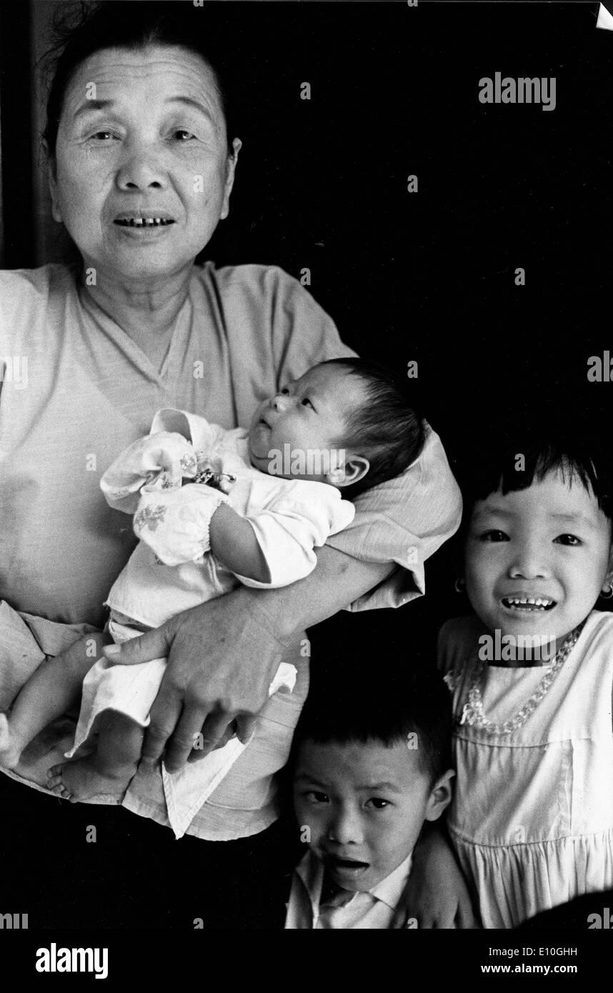 Vietnamese woman and children Stock Photo