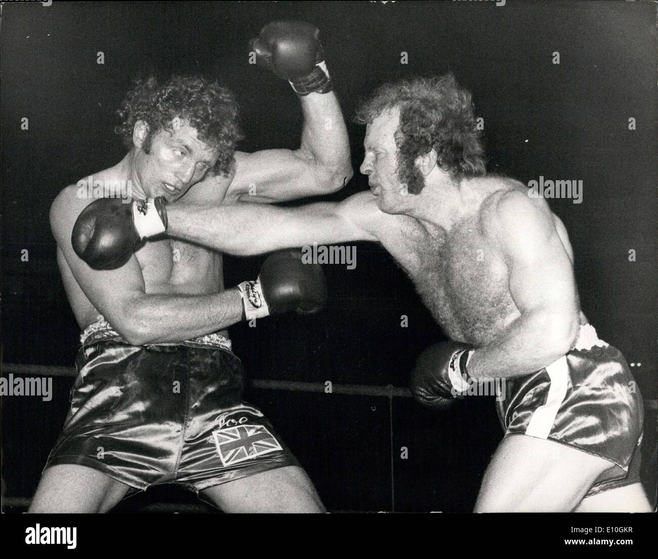 Jan. 17, 1973 - Joe Bugner retains European title.: Joe Bugner retained his European heavyweight title last night when he beat Rudi Lubbers of Holland on points, at the Royal Albert Hall, London. Photo shows Joe Bugner (left) ecaden a right from Rudi Lubbers, during their fight last night. - Stock Image
