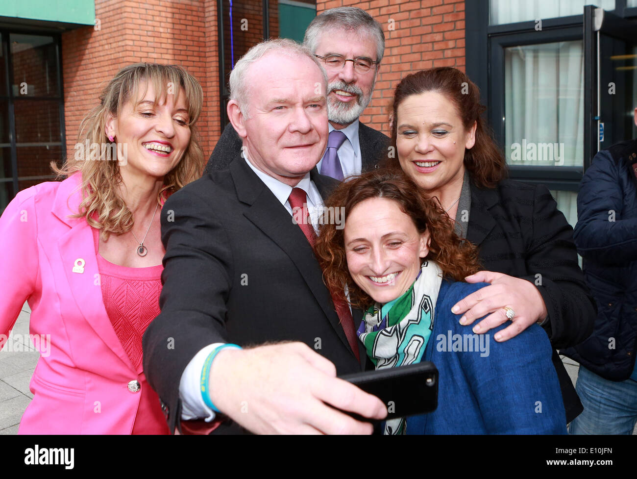 Sinn Fein's Martin McGuinness sets up selfie with Party Leader Gerry Adams, Martina Anderson, Lynn Boylan & Mary Lou McDonald at - Stock Image