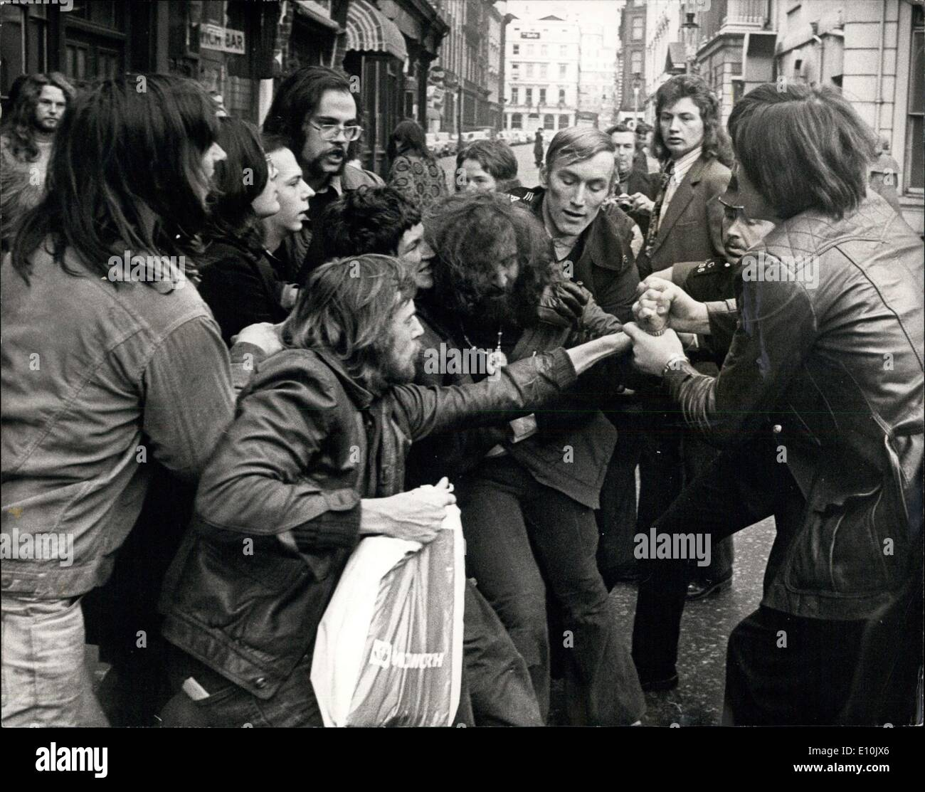 Mar. 10, 1973 - March 10th 1973 Women's Lib and supporters stage sit-down in Trafalgar Square Post Office after rally. Women's Lib marchers who marched through London this afternoon to a rally in Trafalgar Square during which a break away group marched to the Trafalgar Square Post Office and stage a sit-in, in protest against Family allowance pay-outs. Police were called and they cleared from the post office making some arrests. Photo Shows: Women's Lib and supporters seen struggling with police outside the post office today. Stock Photo