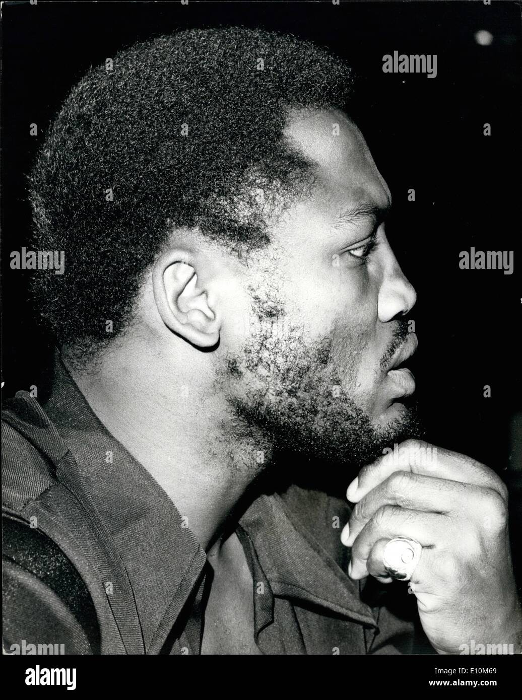 Jun. 06, 1973 - Will Frazier's beard have to go.: The former world heavyweight champion, Joe Frazier, together with Britain's Joe Bugner, who meet at Earls Court, London, next Monday, went along to the Empire Ballroom, Leicester Square, to go over the rules of the fight, during which Frazier was in dispute with Bugner's manager, Andy Smith, as to whether he will be allowed to retain his beard. The B.B.B. of C are considering the issue. Photo shows Joe Frazier thoughtfully fingers his beard, today. - Stock Image