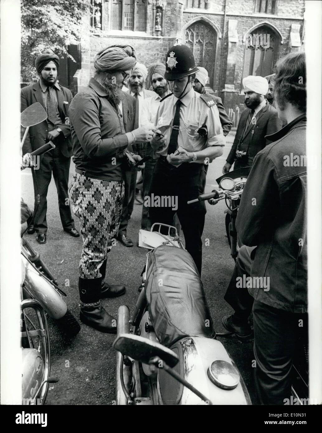 Aug. 08, 1973 - Sikh Defies Ruling On Crash Helmets: An English-born Sikh was fined 1 on each of 14 summons for failing to wear a crash helmet in accordance with the new motor cycle regulations, when he appeared at Bedford Magistrates court yesterday. He drove away from court still without protective headgear. Hans Walter Powles, of Salisbury Road, Bedford who changed his name to Mohan Hartung Singh when he was converted to the Sikh religion two years ago, told the magistrates his head belonged to God and would not remove his turban to put on a crash helmet - Stock Image