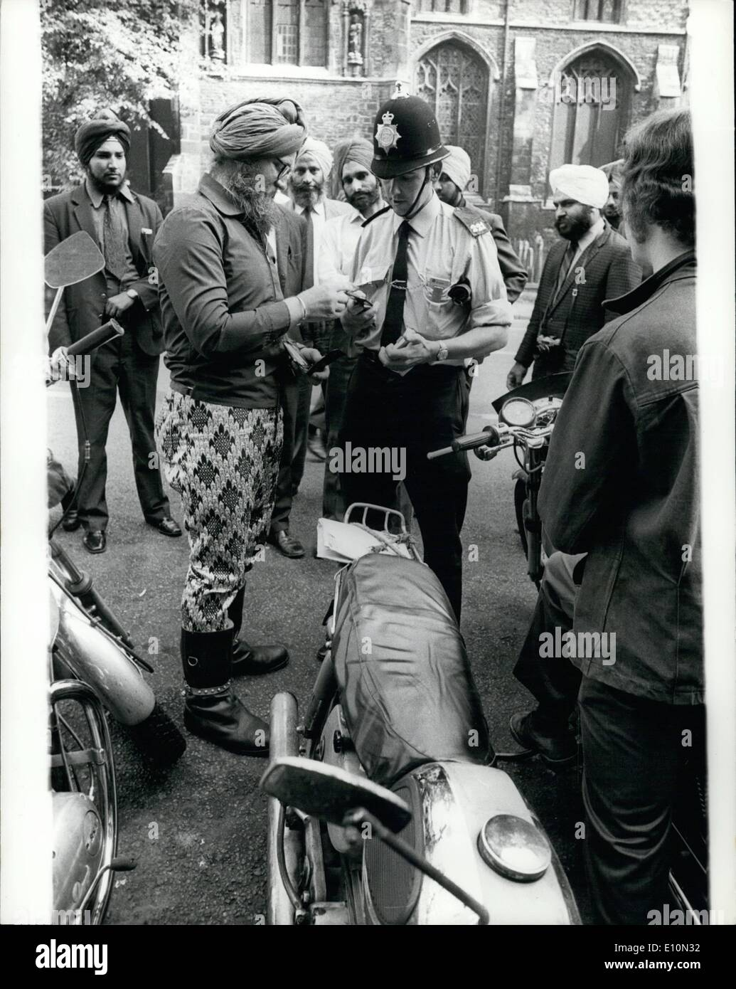 Aug. 08, 1973 - Sikh Defies Ruling On Crash Helmets: An English-born Sikh was fined 1 on each of 14 summonses for failing to wear a crash helmet in accordance with the new motor cycle regulations, when he appeared at Bedford magistrates court yesterday. He drove away from the court still without protective headgear. Hans Walter Powles, of Salisbury Road, Bedford, who changed his name to Mohan Hartung Singh when he was converted to the Sikh religion two years ago, told the magistrates: ''his head belonged to God'' and h e would not remove his turban to put on a crash helmet - Stock Image