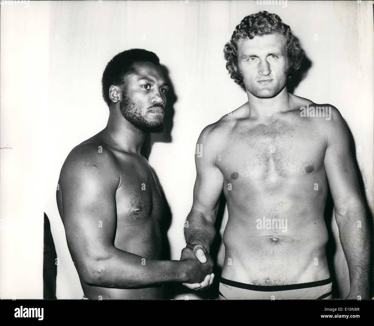 Jul. 07, 1973 - Bugner And Frazier Weigh-In For Tonight's Fight: Joe Bugner, the European Heavyweight Champion, and Joe Frazier, the Former world champion, today weighed-in for their fight tonight at Earls Court, London.Photo Shows Joe Frazier and Joe Bugner shaking hands at today's weigh-in. - Stock Image